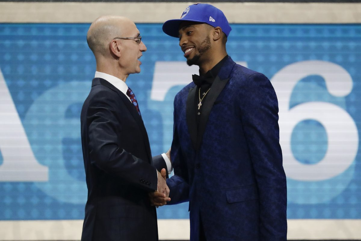 Sixers first round pick Mikal Bridges shakes hands with NBA Commissioner Adam Silver during the 2018 NBA draft on Thursday, June 21, 2018 in Brooklyn.