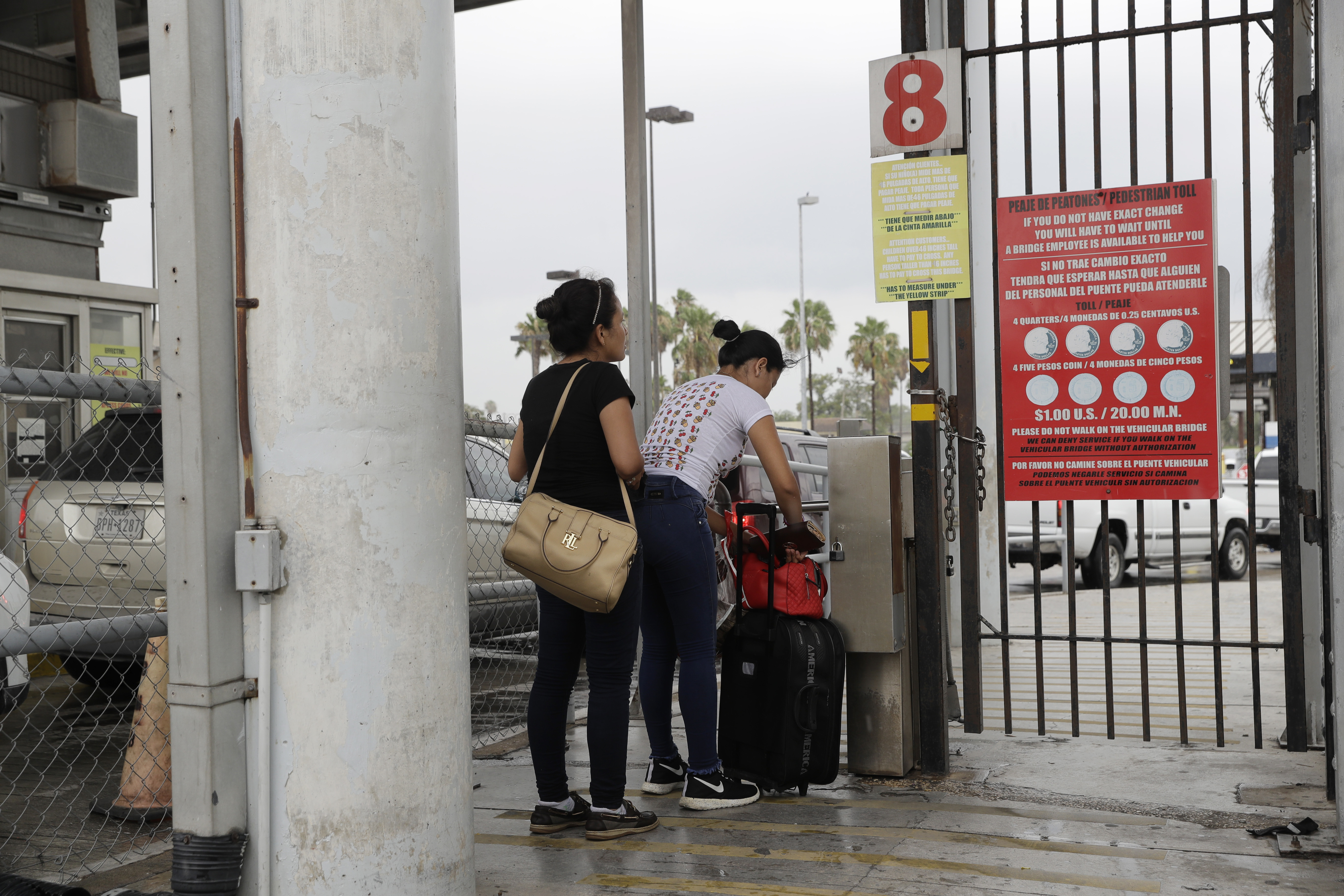 Josseline Garcia, 20, and Jennifer Garcia, 24, sisters from Guatemala seeking asylum, cross a bridge to a port of entry in to the United States from Matamoros, Mexico, Wednesday, June 20, 2018, in Brownsville, Texas.