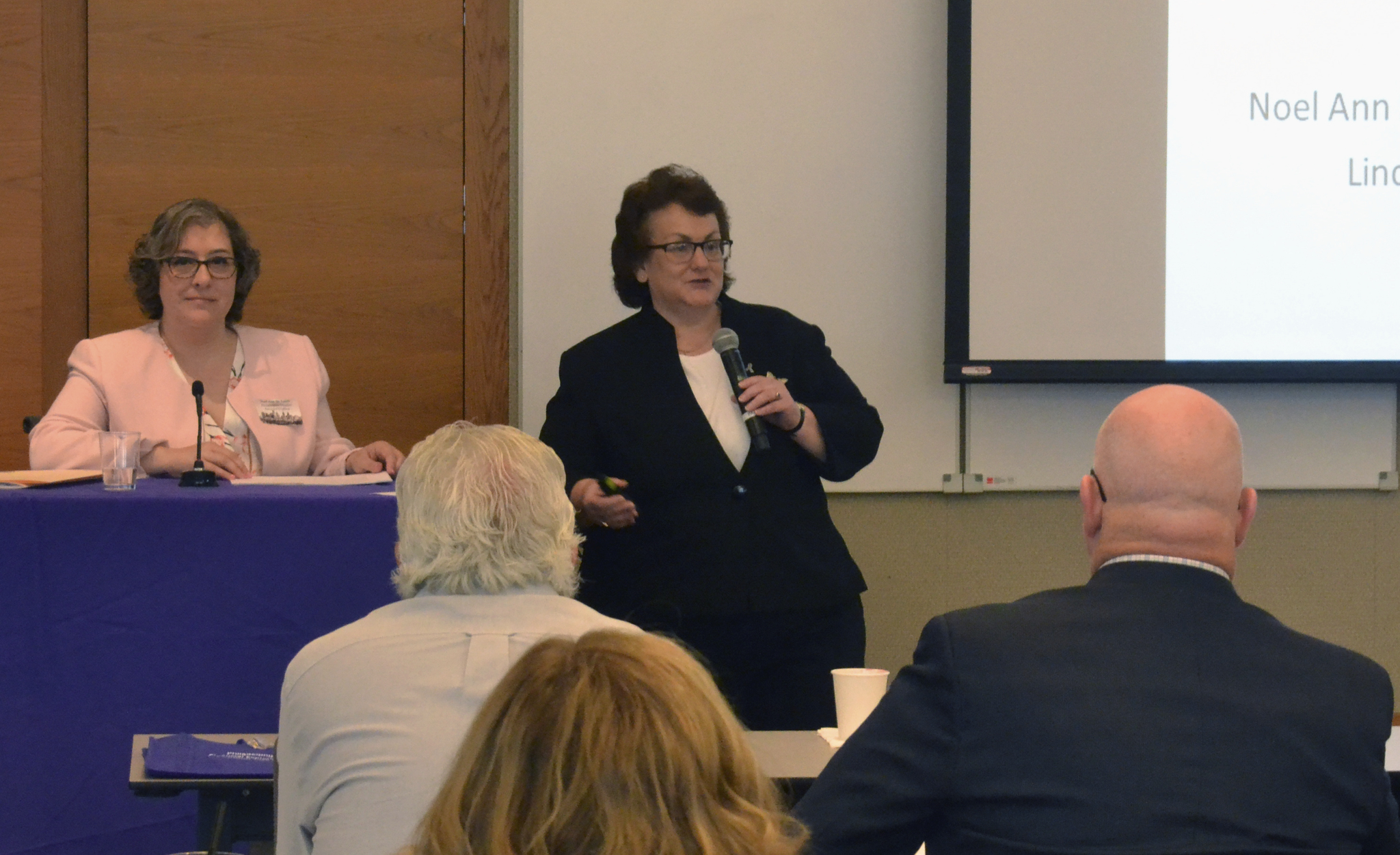 Assistant D.A. Noel Ann DeSantis, left, and Linda Mill of Ally Bank spoke on elder financial exploitation at the Federal Reserve Bank of Philadelphia on Friday, June 22, 2018. (Credit: Terrence Casey/Penn Memory Center)