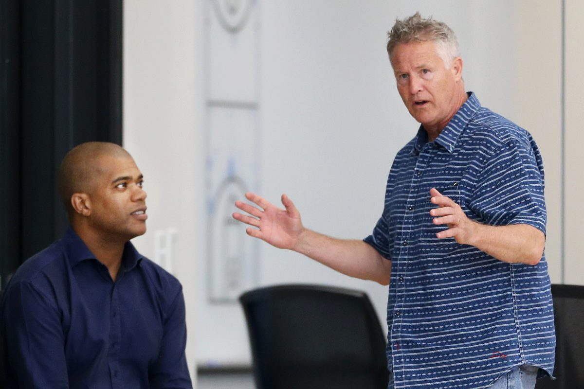 Vice president of player personnel Marc Eversley (left) talks with head coach and interim general manager Brett Brown.