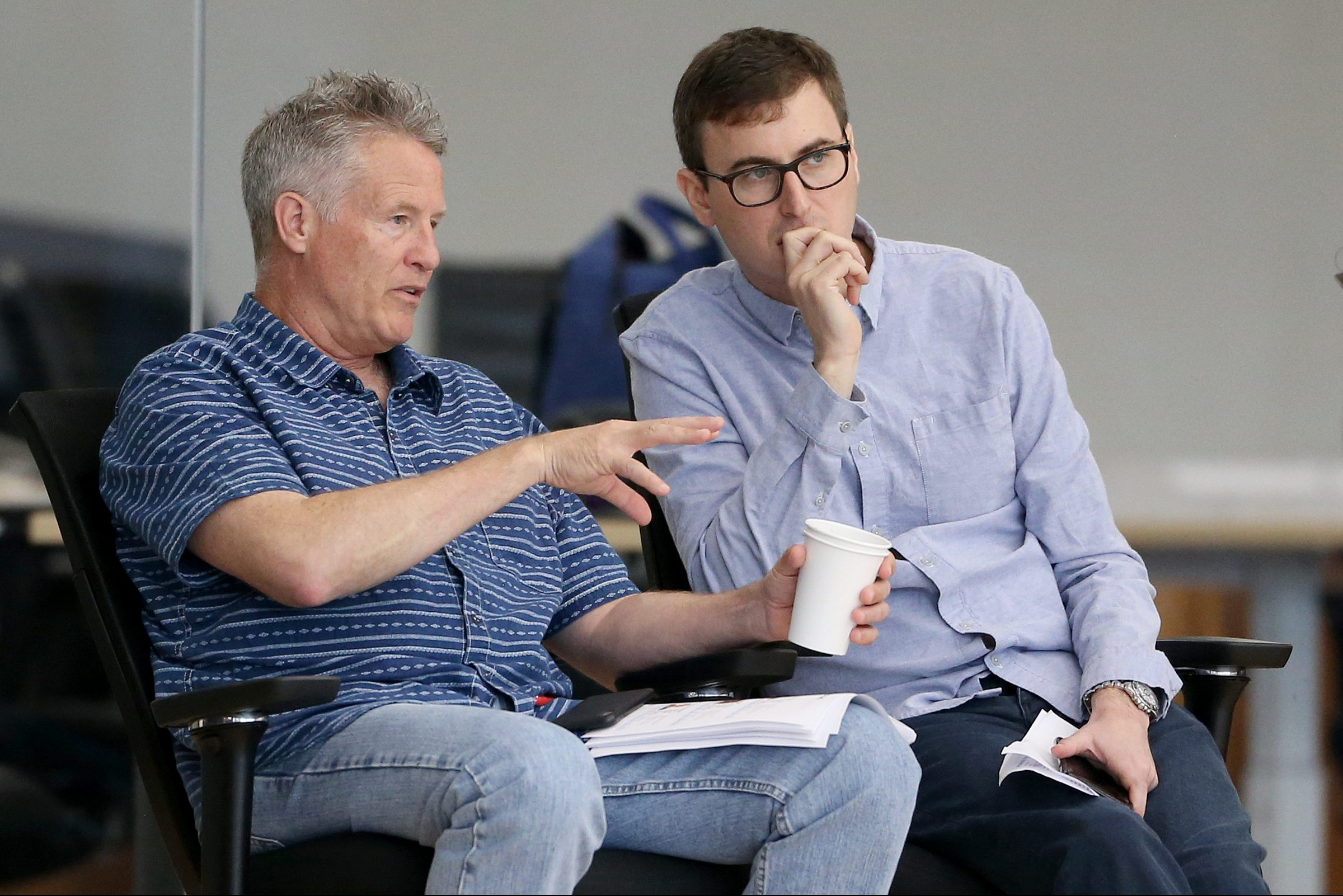 Head coach and interim general manager Brett Brown, left, and vice president of basketball operations Ned Cohen watch prospects during a pre-draft workout at the Sixers Training Complex in Camden, N.J., on Wednesday, June 13, 2018.