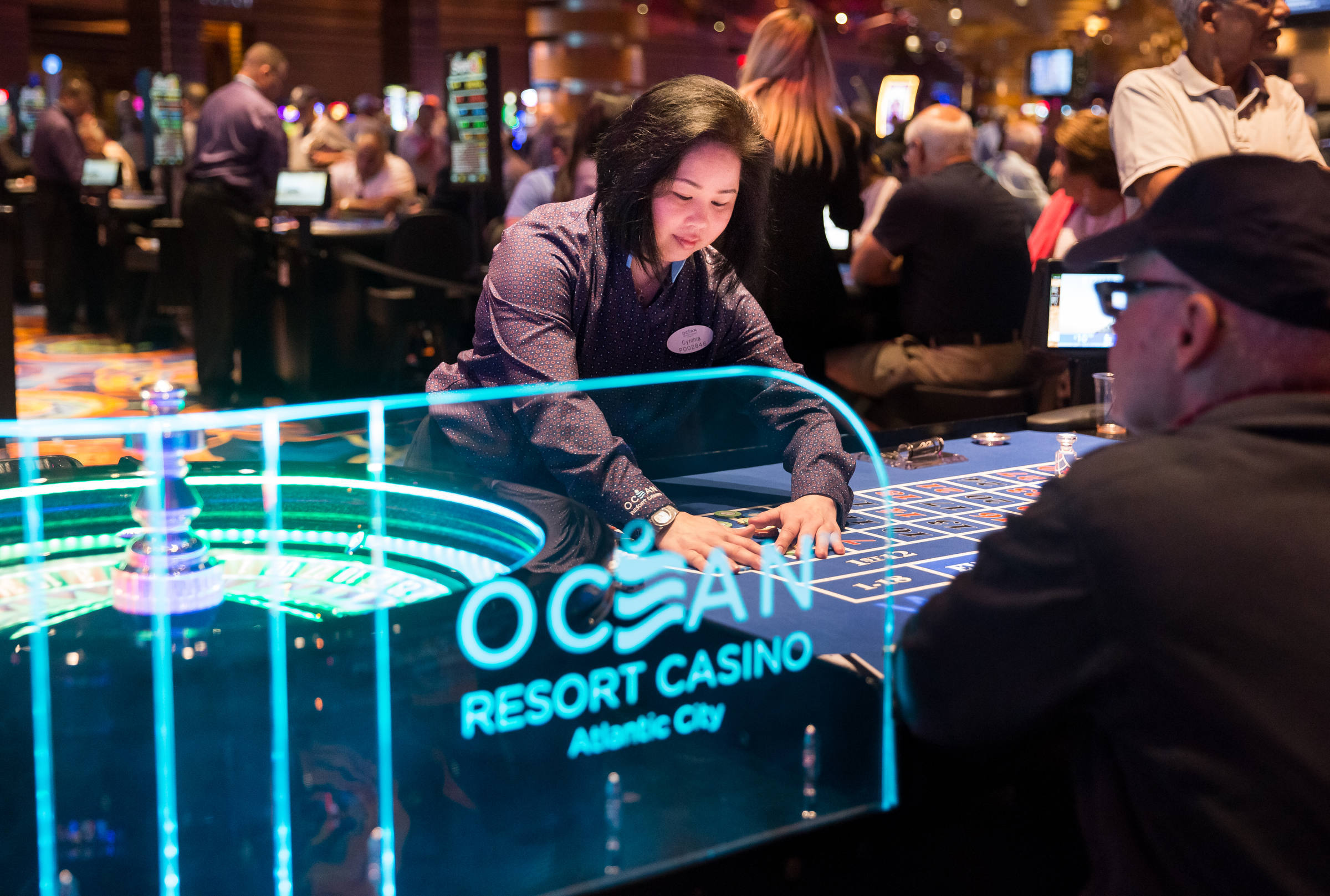 Cynthia Chou, center, a table games dealer, works at Ocean Resort Casino, in Atlantic City, New Jersey, Thursday, June 28, 2018.