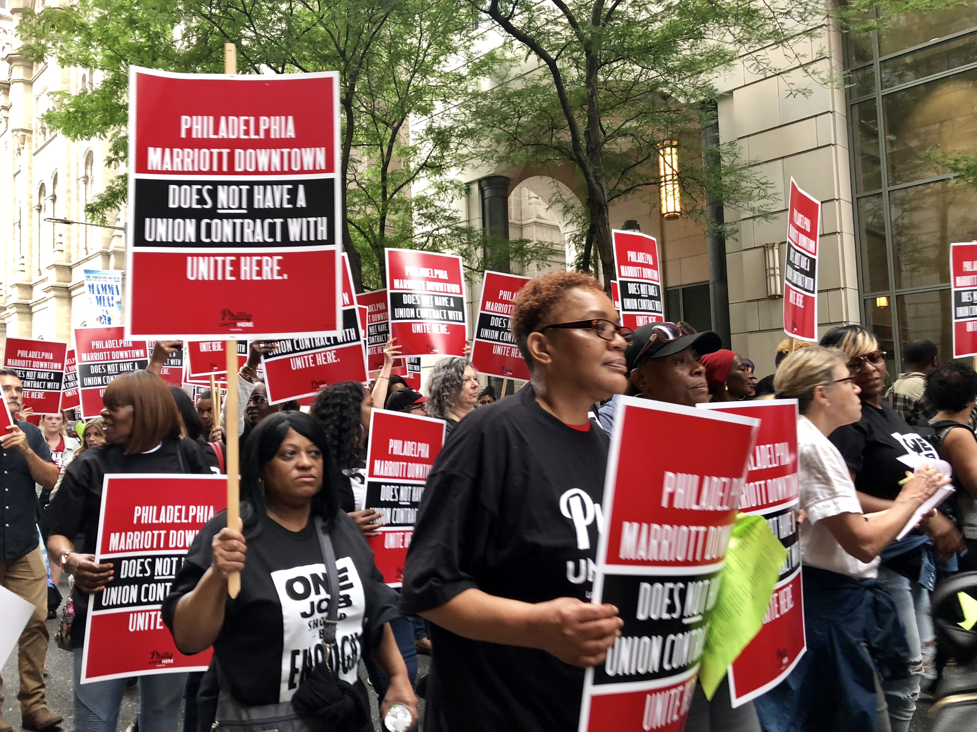 Marriot Downtown workers marched past their workplace to raise awareness for their union campaign on Wednesday, June 27.