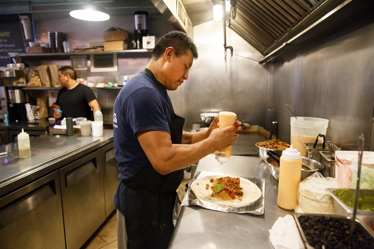 Cook Ignacio Atonal makes a vegan Biff Burrito at Honest Tom's Taco Shop, in West Philadelphia. Honest Tom's is going vegan.