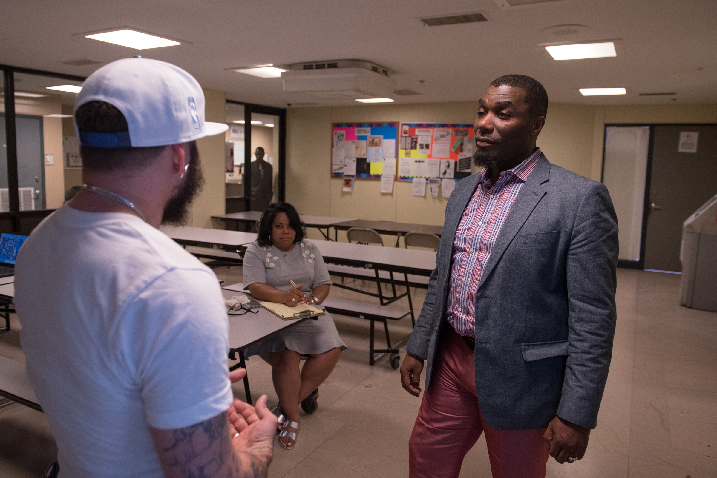Michael Hinson, President and COO of SELF, Inc., speaks with Ruben Montijo at Station House , a shelter in North Philadelphia. After boumcing from halfway house to halfway house, Montijo stayed at the shelter for three years, until he got his own apartment in May.