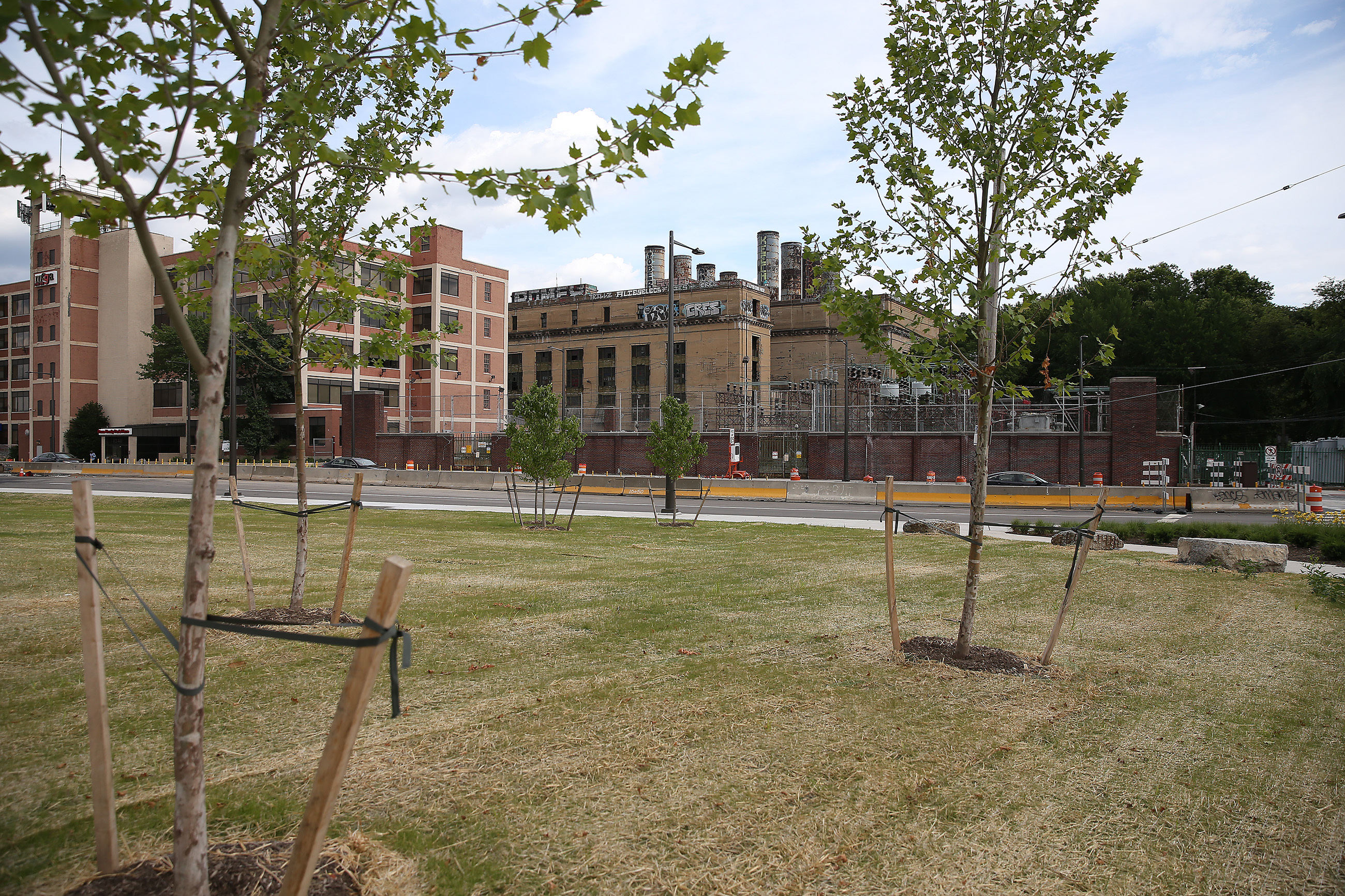 As part of the reconstruction of I-95, PennDOT has added new green space along Delaware Avenue, reducing the divide between Fishtown and the river. The former PECO station could become a wedding hall. DAVID MAIALETTI / Staff Photographer