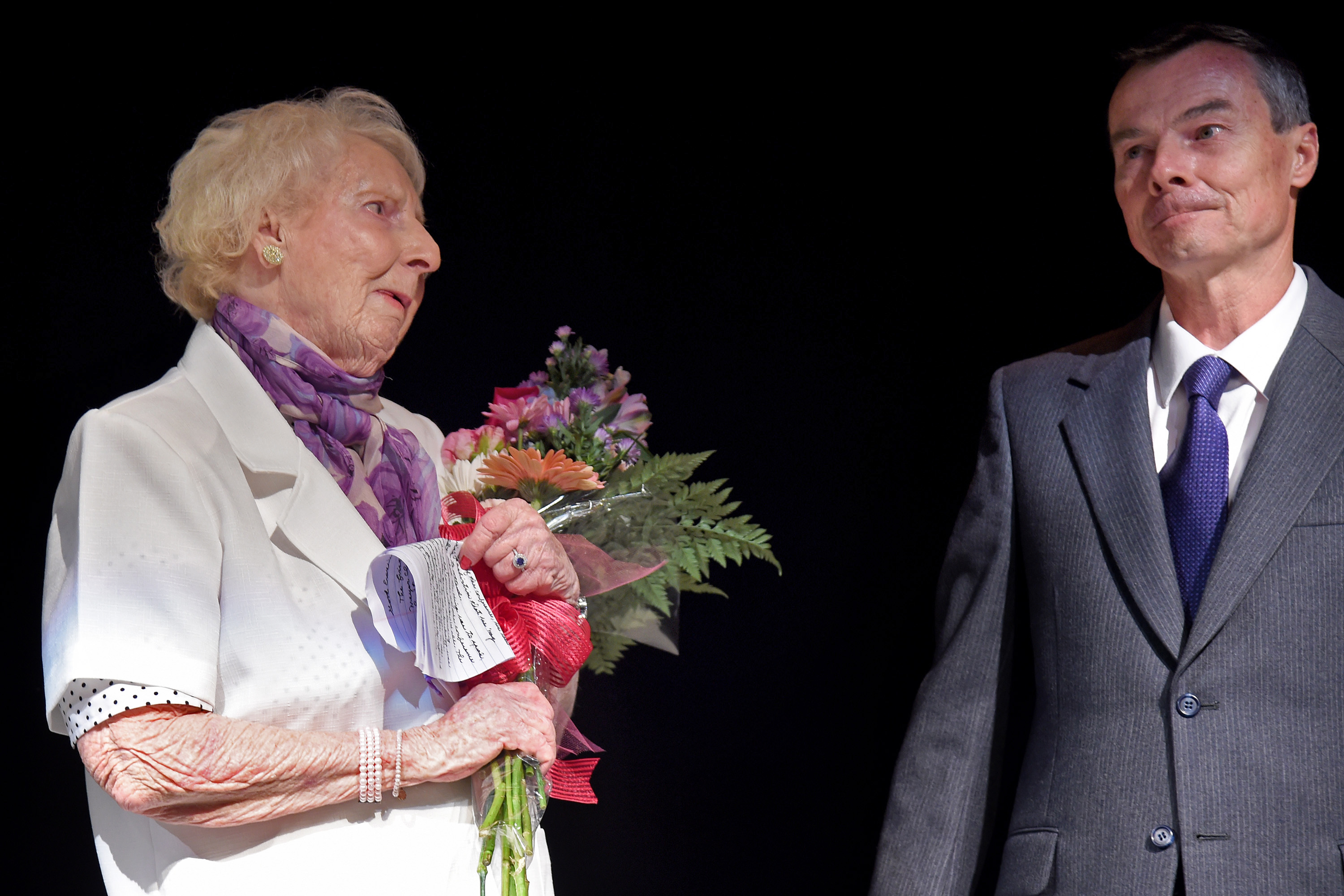 Anna Wright, 89, of Newtown Square, who was in attendance 60 years earlier when Martin Luther King Jr. addressed a convention of Quakers in Cape May, is presented with flowers after speaking at the city´s commemoration of the anniversary June 27, 2018. With her is nephew James TerBush,