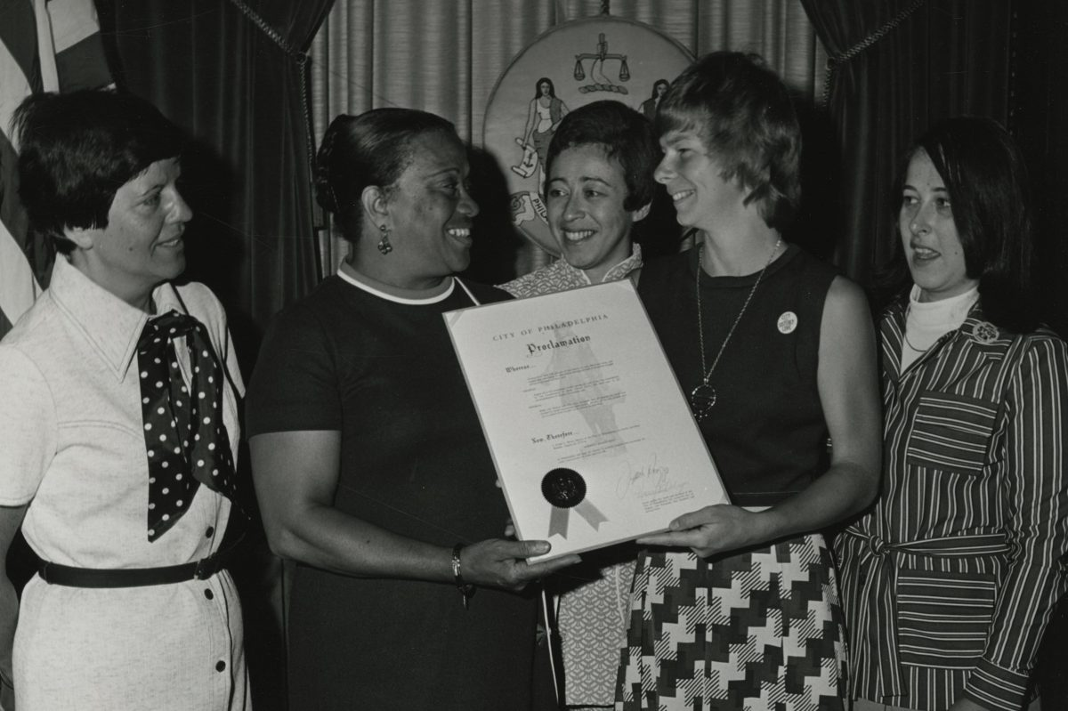 """Receiving the City of Philadelphia's proclamation of August 26, 1974 as """"Women's Rights Day,"""" photograph (1974), National Organization for Women, Philadelphia Chapter records."""