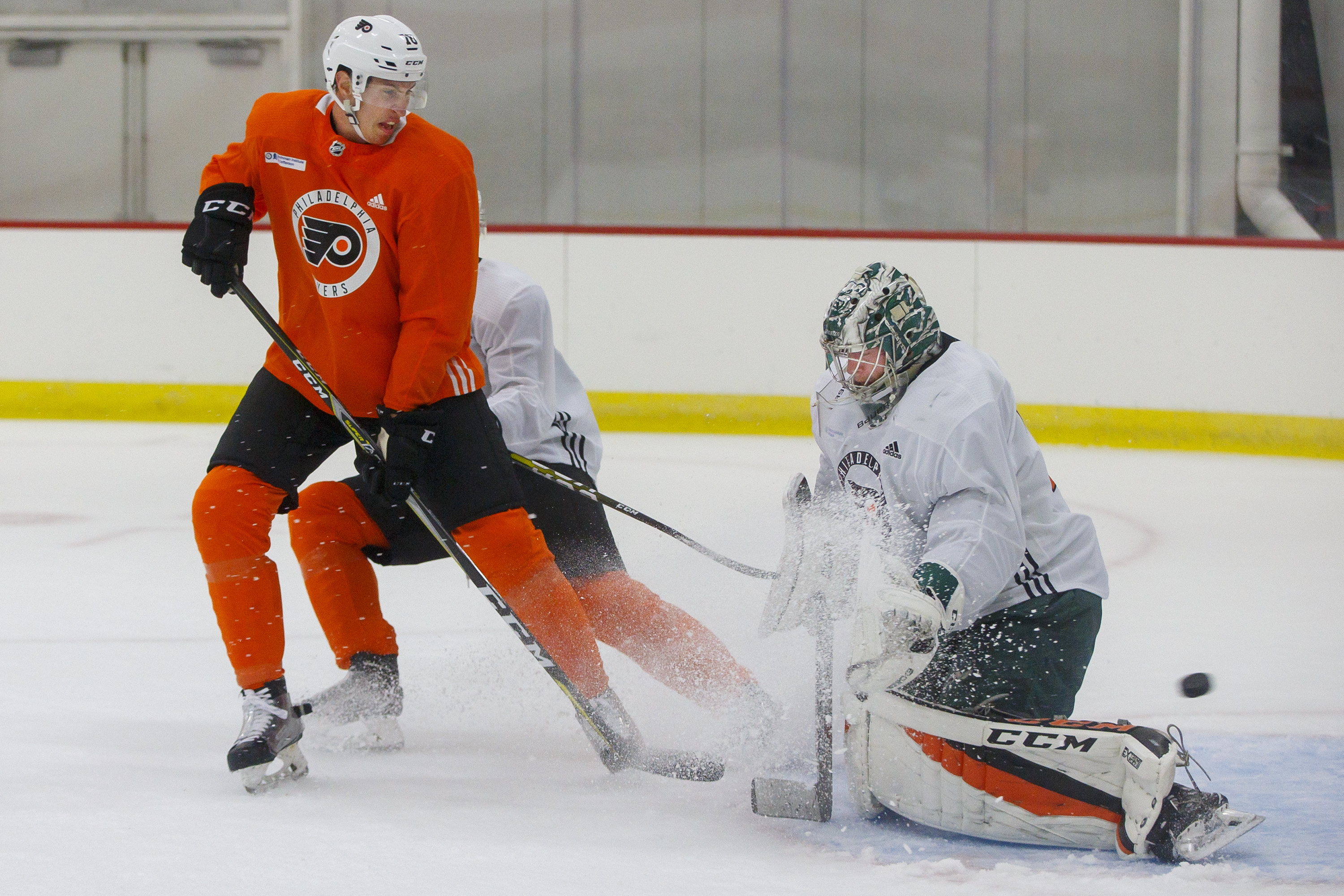 Flyers Isaac Ratcliff. left, gets the pick past goalie Carter Hart, right, during a 3 on 3 game at the Flyers Skate Zone in Voorhees NJ on July 2, 2018.