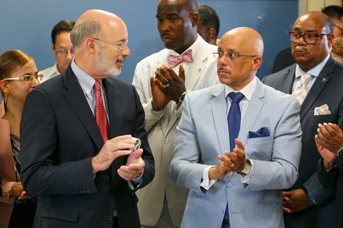 Gov. Tom Wolf, left, with State Sen. Vincent Hughes during a press conference  announcing funds to clean up hazards in Philadelphia  schools.