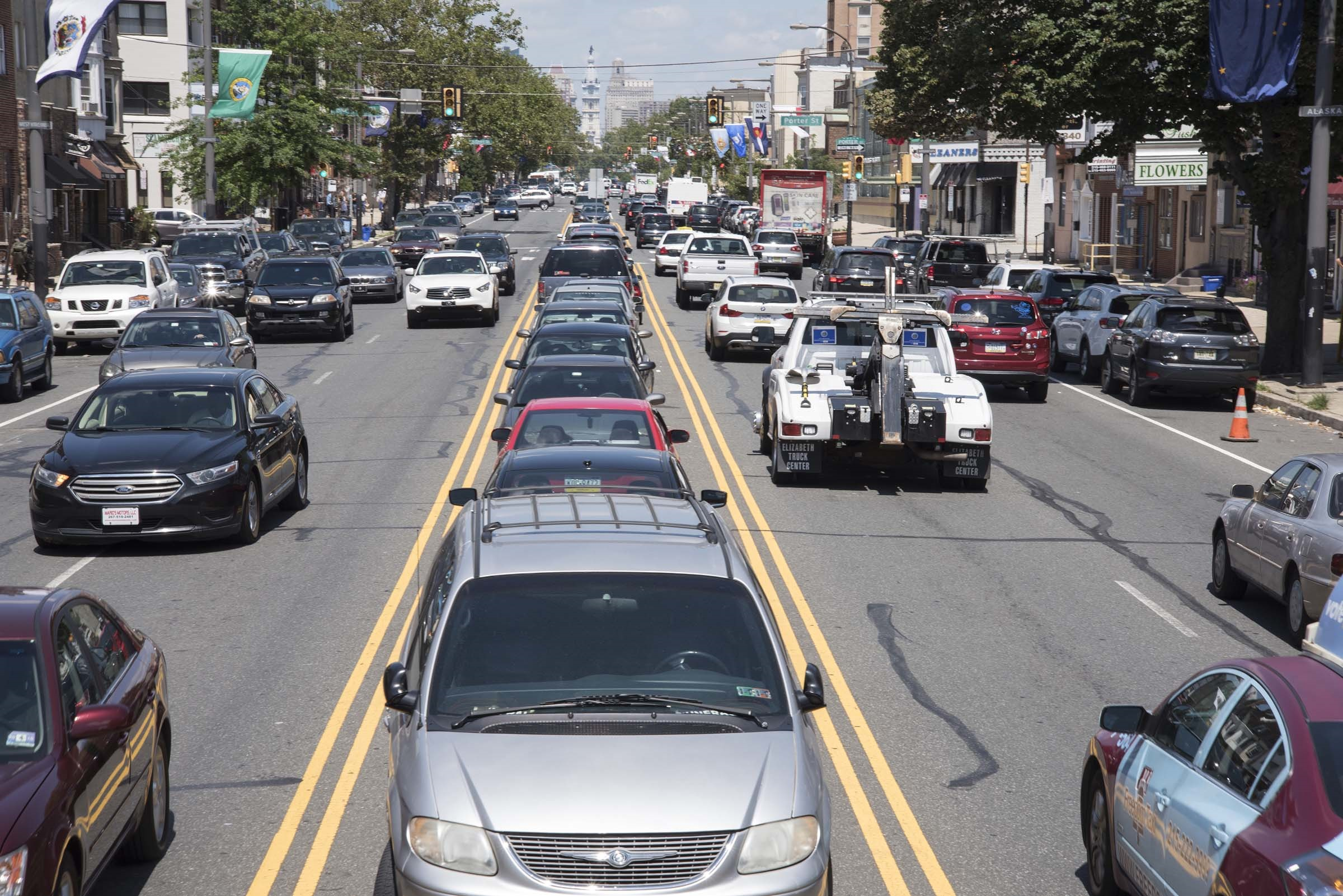 Cars parked in the median of South Broad Street between Shunk and Porter Streets.
