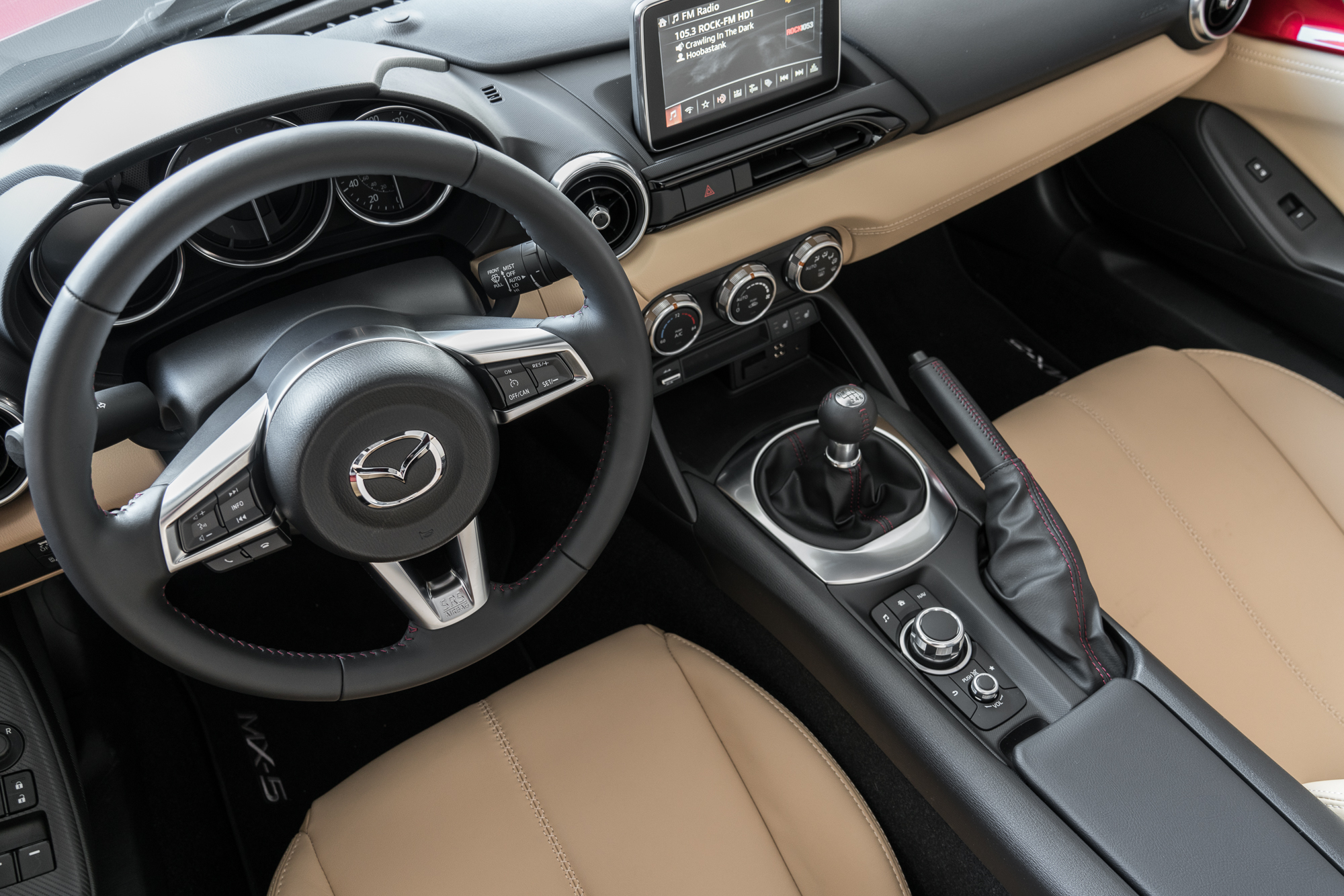 The interior of the 2017 Mazda MX-5 Miata RF matches the MX-5 convertible, and that's a good thing. Unless you're tall.