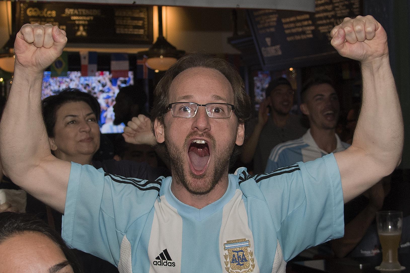 Argentina fan Tomas Alziel celebrates a score during a World Cup game against Nigeria at Fado Restaurant Bar on Locust Street.