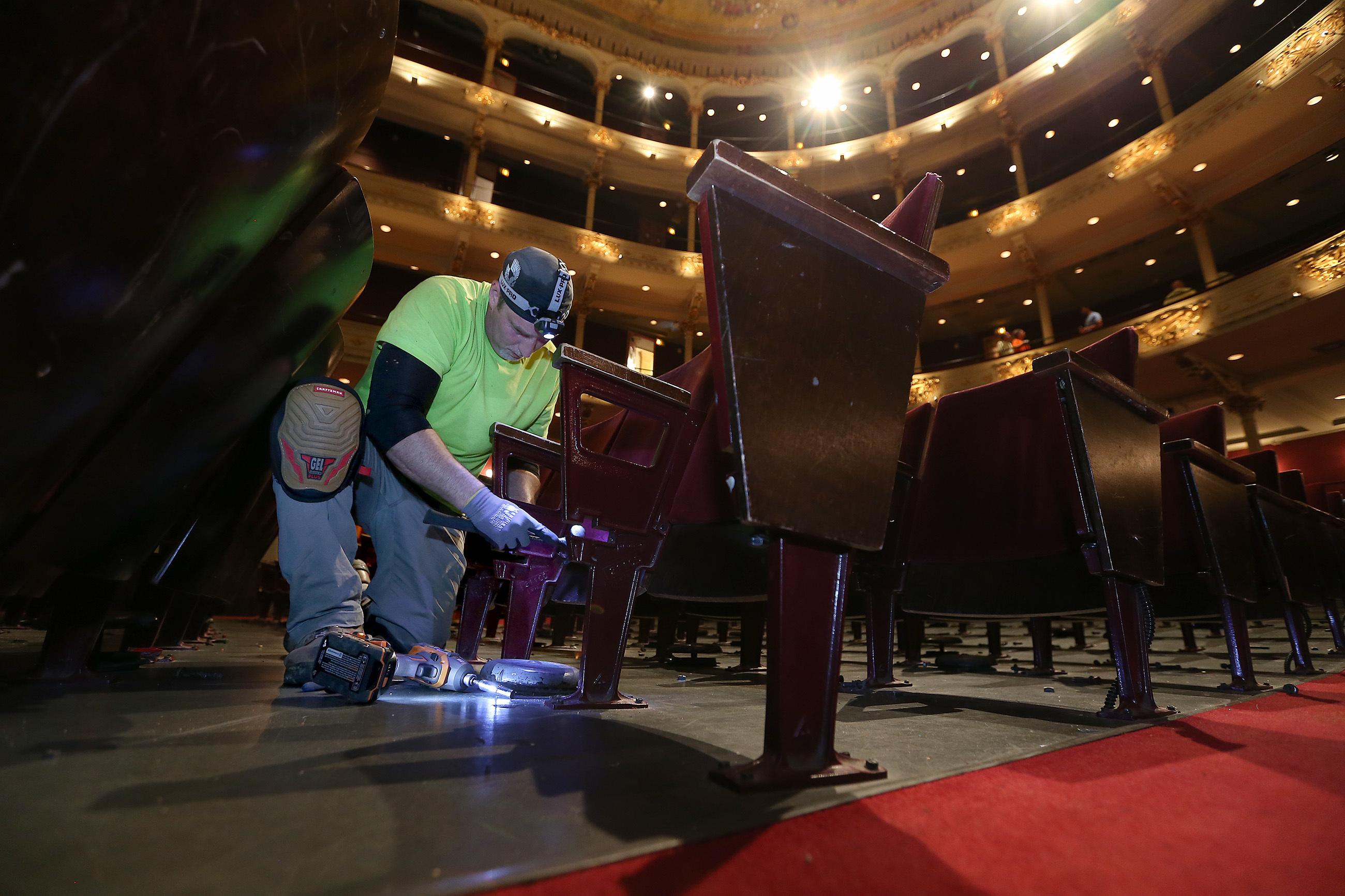Union carpenter Joe Panetta unbolts a seat as the old seats are removed from the Academy of Music in Philadelphia, PA on July 10, 2018. DAVID MAIALETTI / Staff Photographer