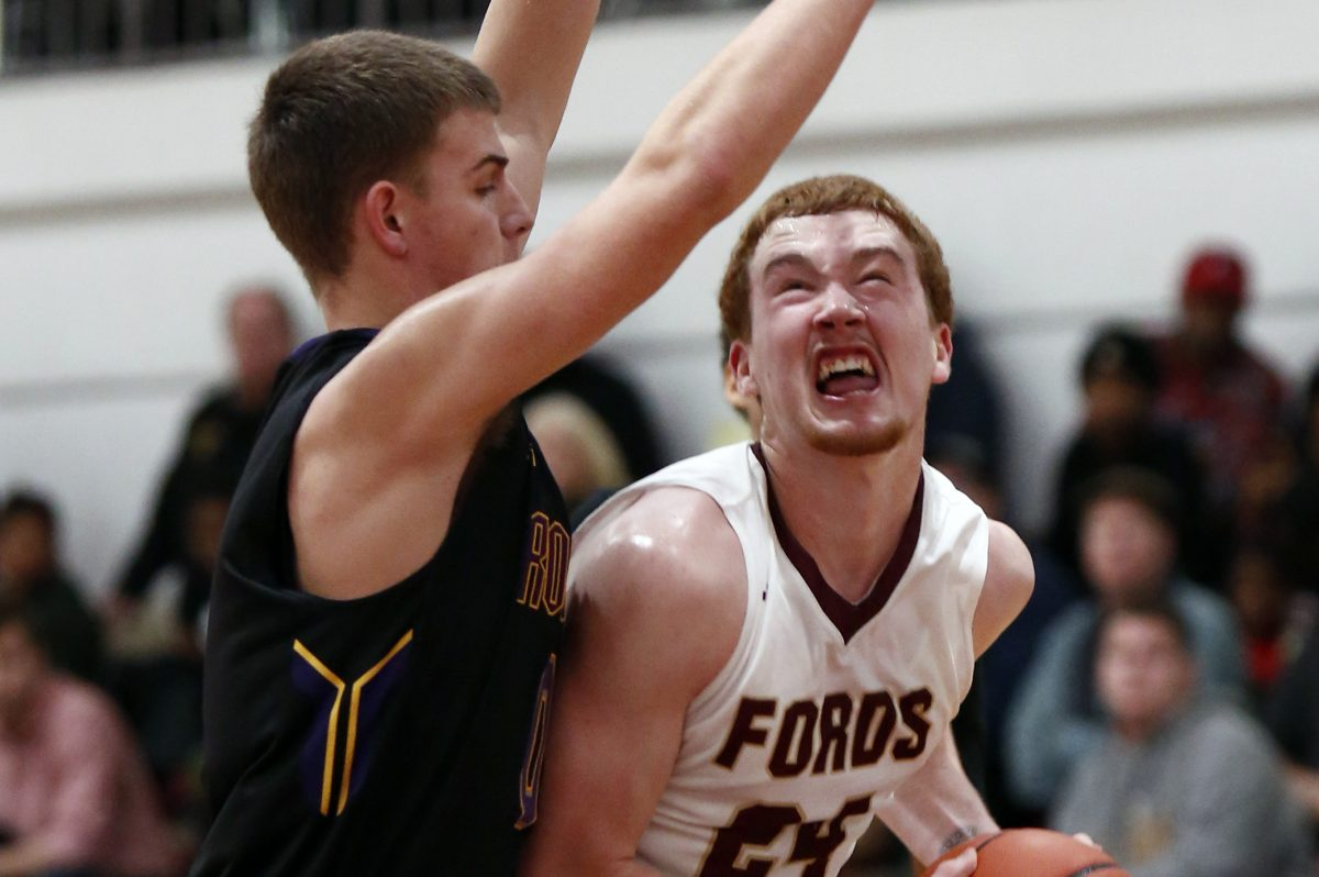 Haverford School's Christian Ray (right) drives against Roman Catholic's Chris Kuhar.