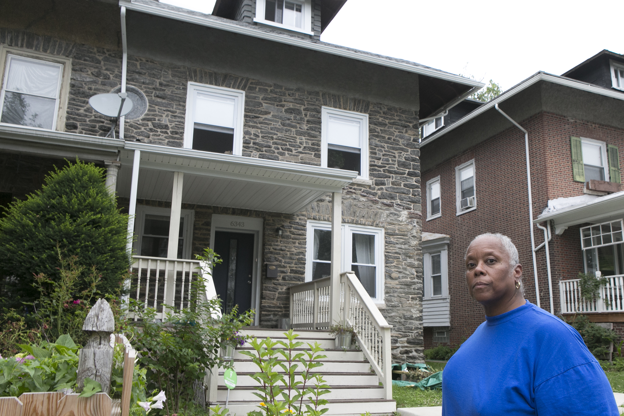 Tonya Bell stands in front of her former Germantown house.