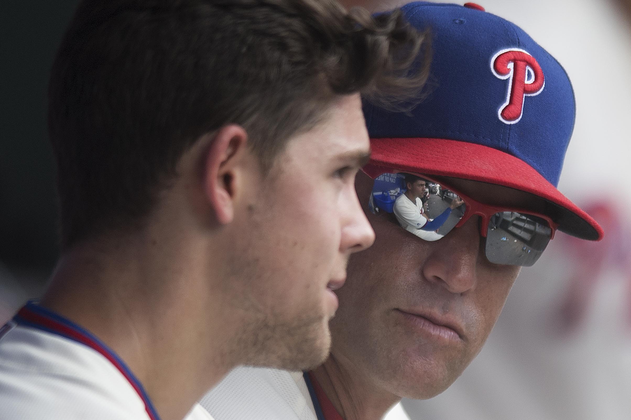Gabe Kapler talking to Scott Kingery, left, during a game last month.