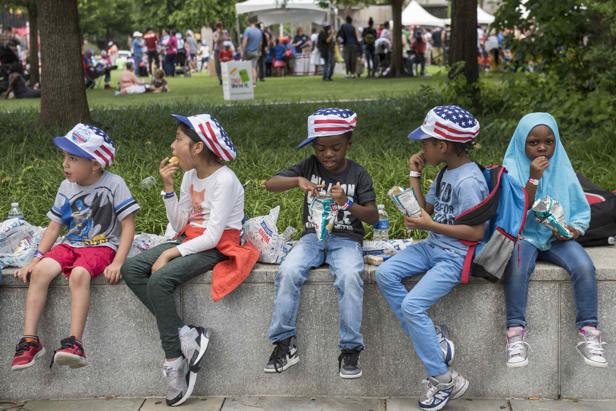 Youngsters in Independence Mall eat their free meals at Wawa´s Hoagie Day Thursday, June 28, 2018, part of the Welcome America July Fourth festivities.