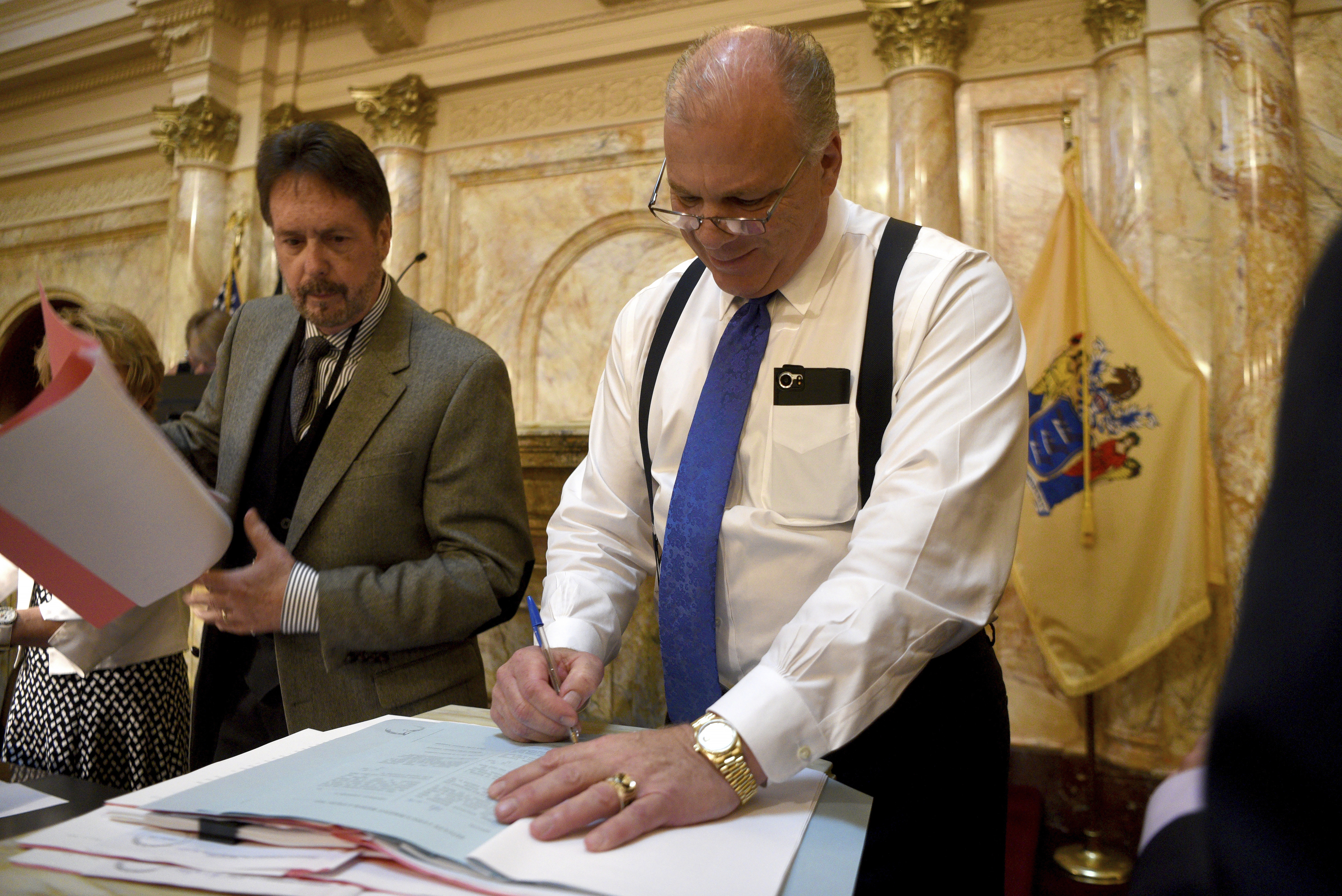 Senate President Stephen Sweeney, right, is locked in a power struggle with Gov. Murphy.