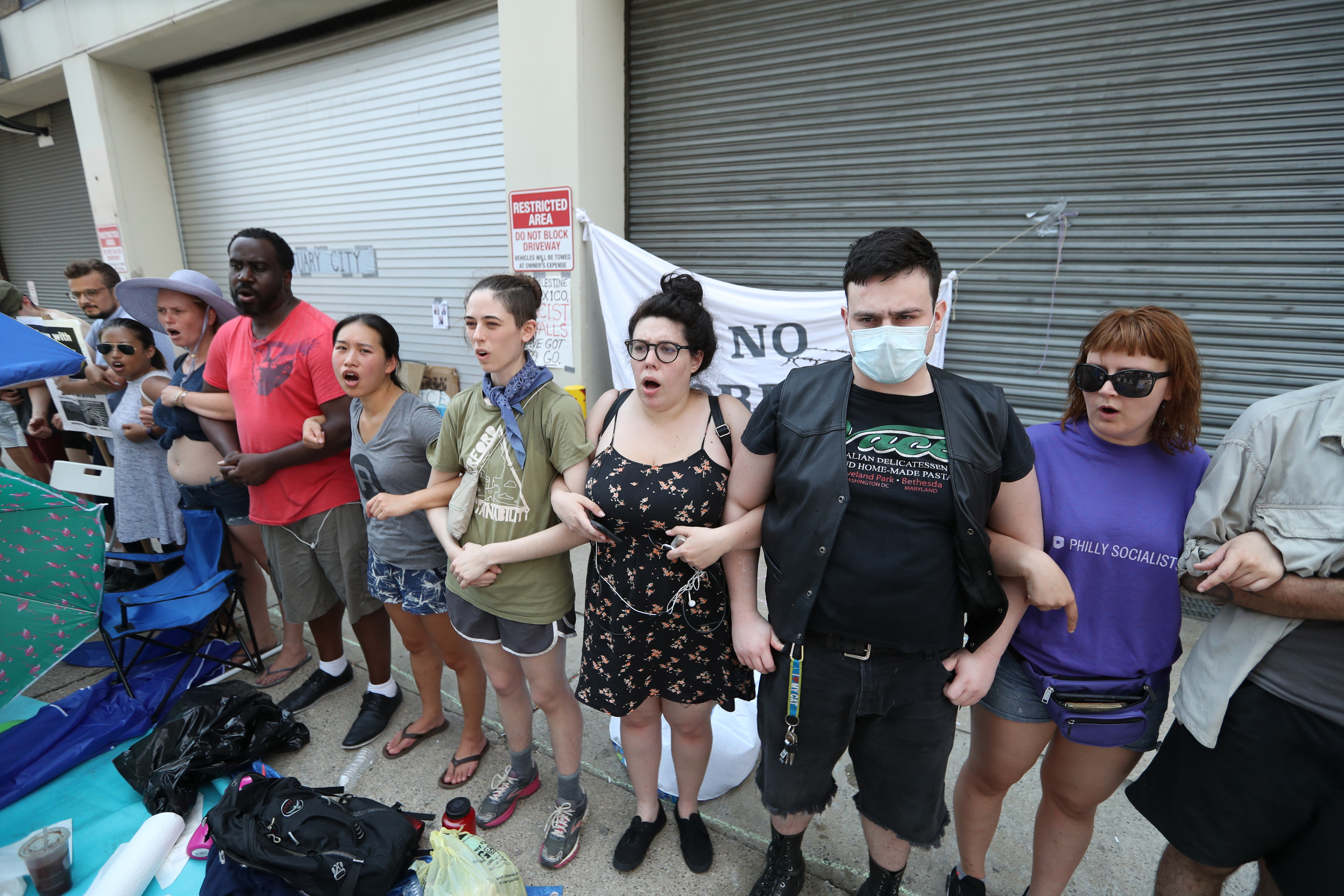 About a dozen protestors are arrested outside the Immigration and Customs Enforcement office in Center City after demanding an end to the agencyÕs policies and cooperation between the city of Philadelphia and ICE, Tuesday July 3, 2018. DAVID SWANSON / Staff Photographer .