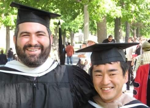 Michael Contreras (left) and Junnosuke Nakamura on graduation day in 2009 at Claremont Graduate University near Los Angeles, Calif. Their friendship developed over rugby and craft beer.