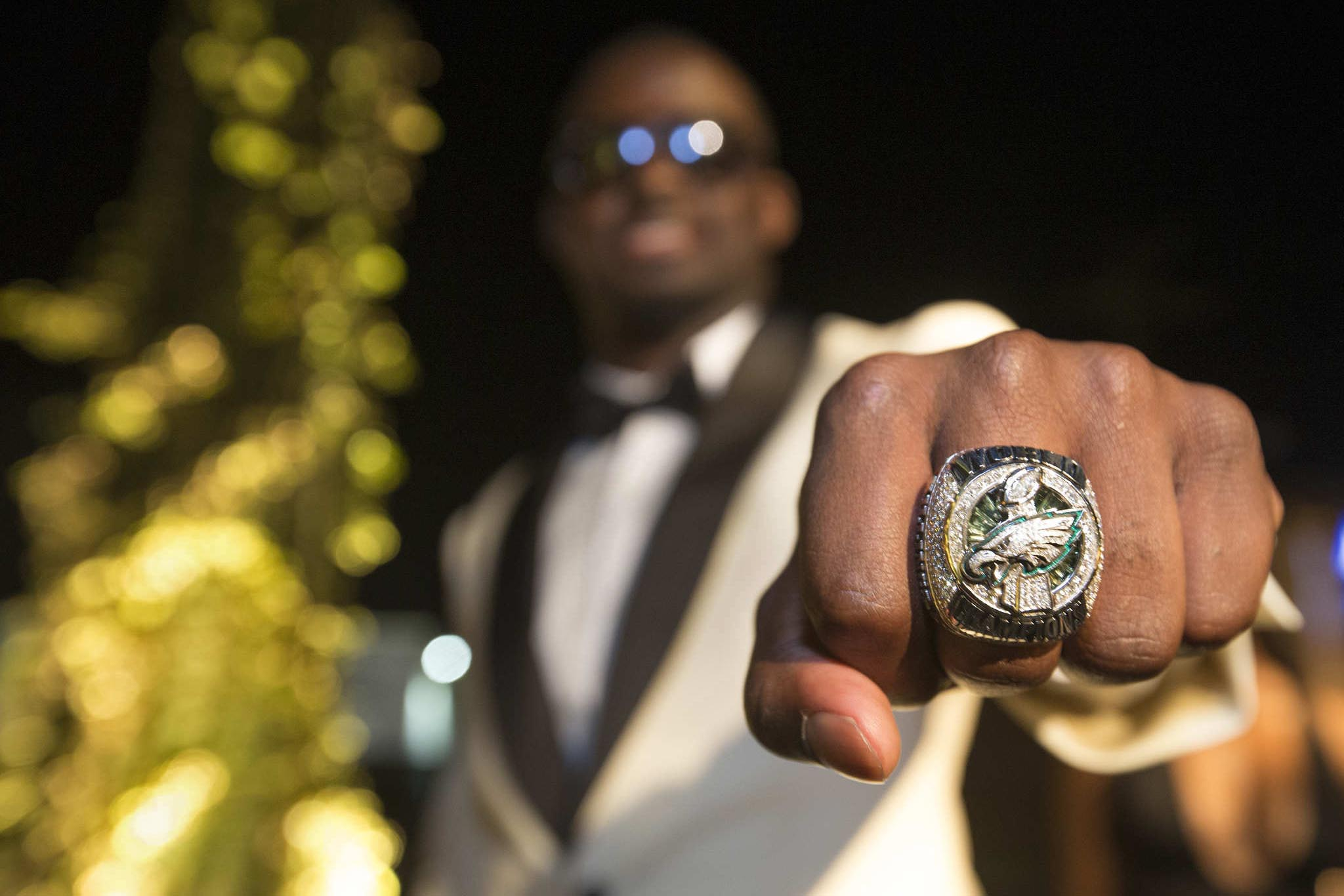Eagles defensive back D.J. Killings shows off his Super Bowl ring at a private team ring party Thursday, June 14, 2018.