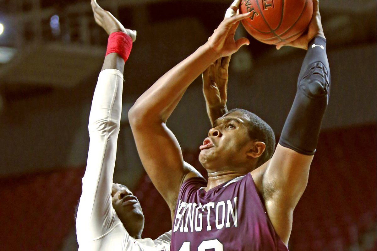 Abington forward Eric Dixon makes his move to the basket past Plymouth Whitemarsh center Naheem McLeod.