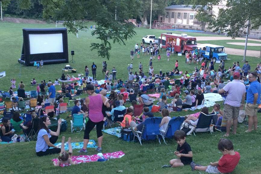 Moviegoers flood the Water Tower Recreation Center lawn.