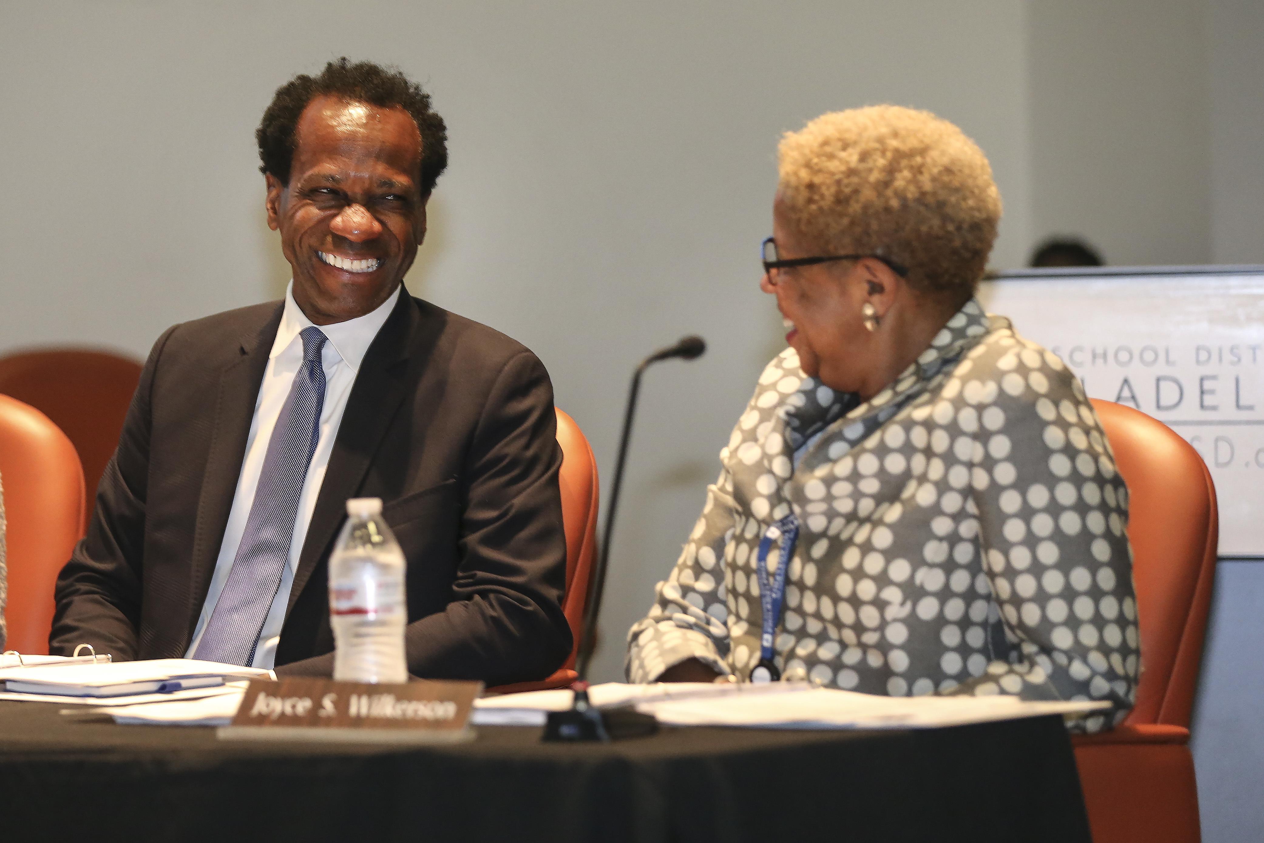 New Philadelphia School Board, Vice President Wayne Walker and President Joyce Wilkerson share a light momnet, Monday, July 9, 2018. STEVEN M. FALK / Staff Photographer
