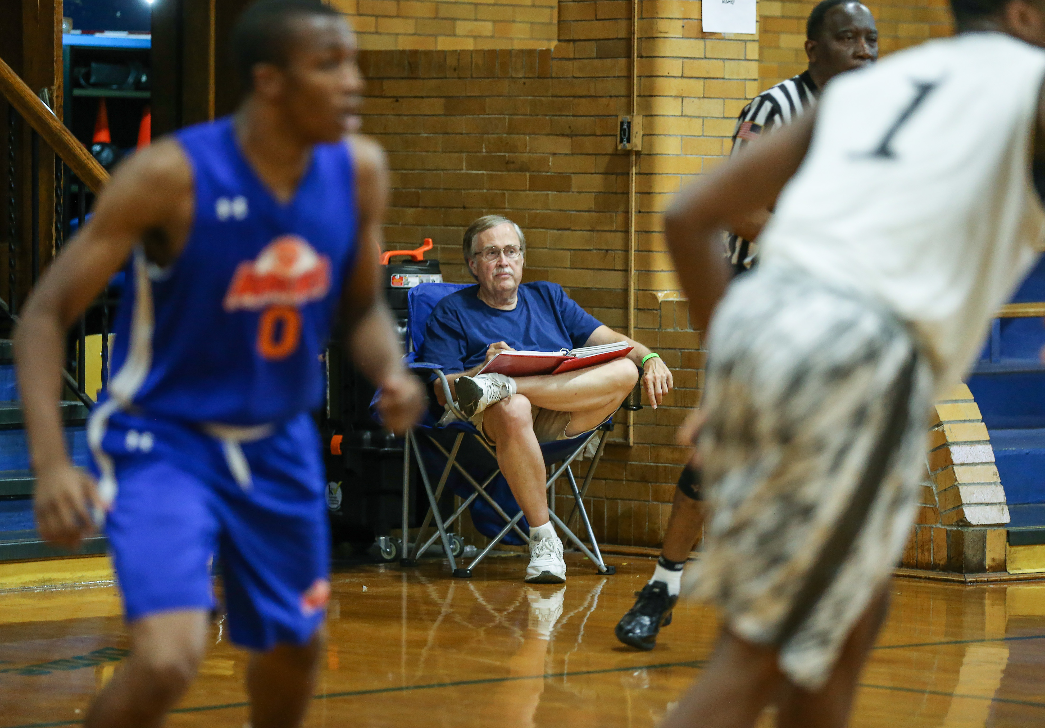 """Watching the """"Battle for Independence"""" tournament Norm Eavenson, a retired school teacher from West Chester, has been a top national talent evaluator for 25 years. He's accredited by NCAA, as required, and respected by every coach out there. West Catholic Prep High School, Sunday, July 2, 2017. STEVEN M. FALK / Staff Photographer"""