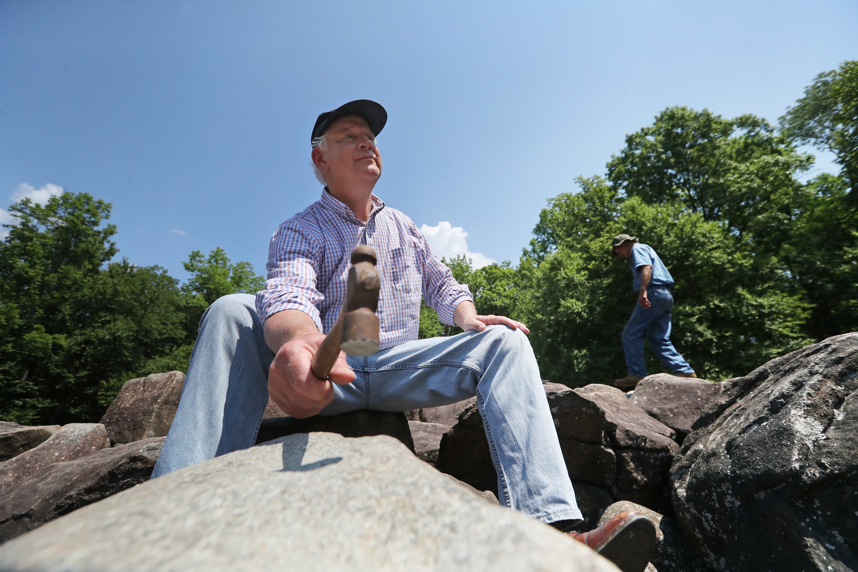 Curtis Nolley, 64, Harrisonburg, VA explores the ringing rocks of Upper Black Eddystone Thursday July 12, 2017.