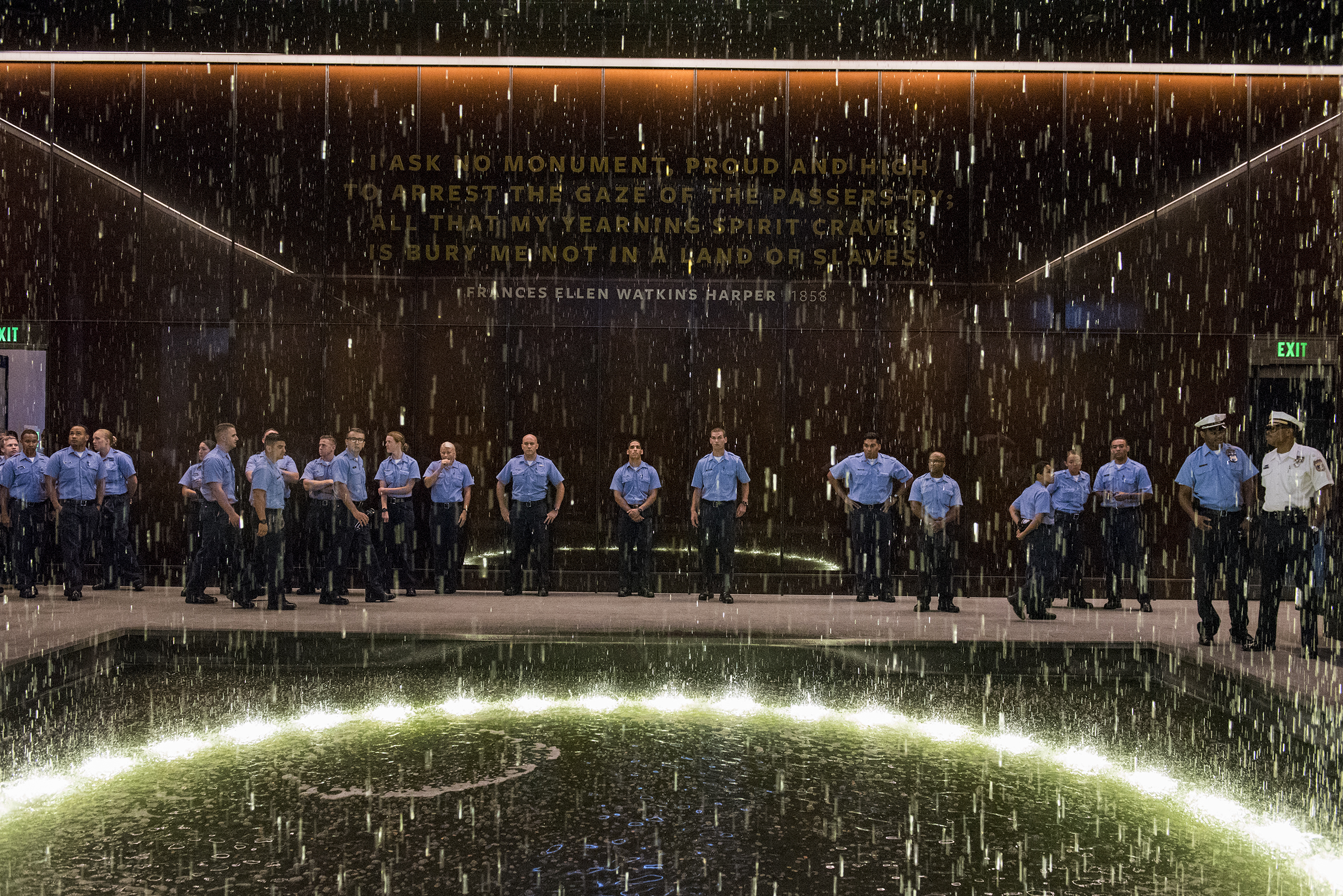 More than 100 Philadelphia police recruits pause inside the Contemplation Court inside the National Museum of African American History and Culture in Washington, D.C. on Tuesday, July 3, 2018.