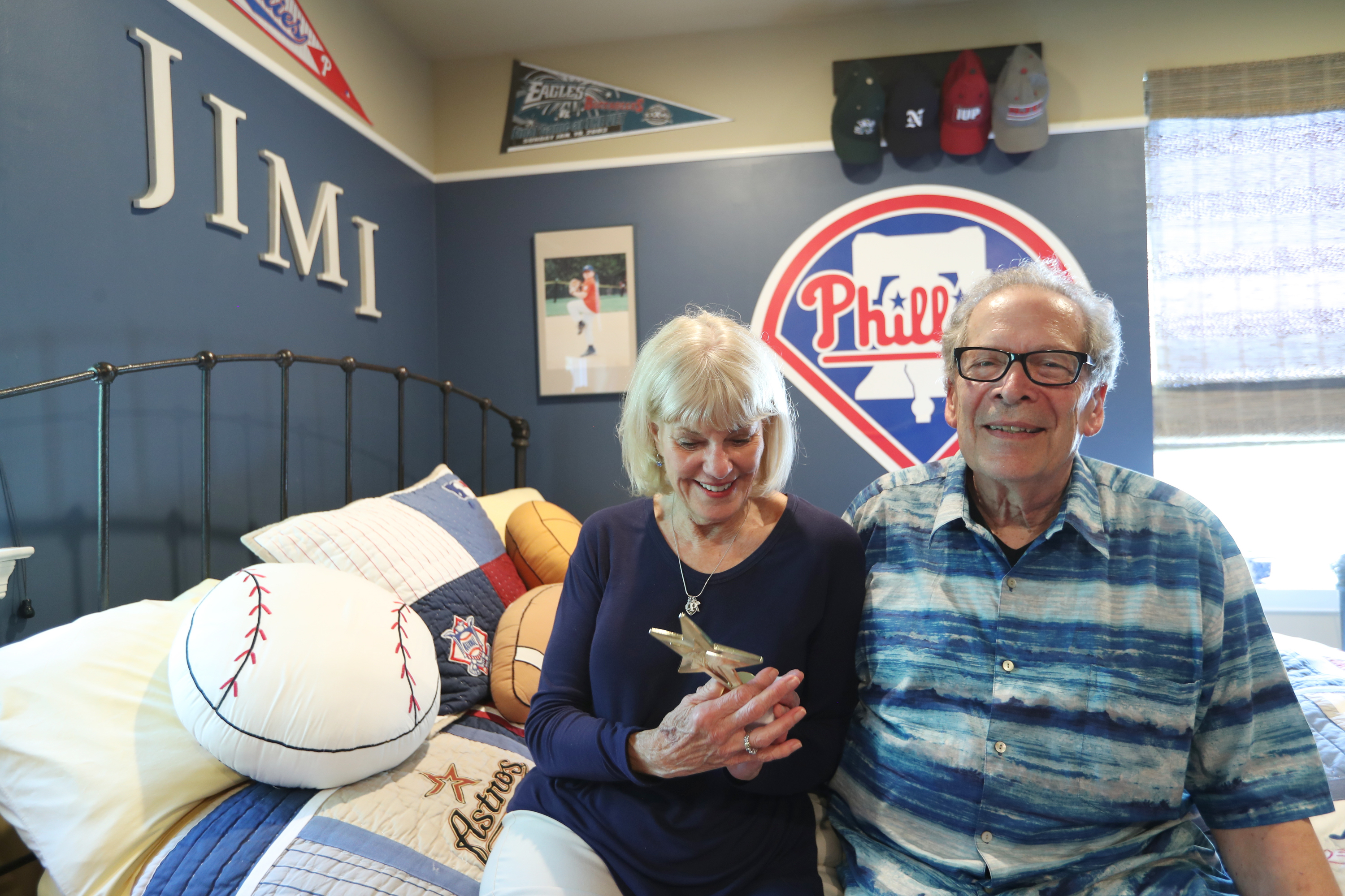 Grandparents Sharon and Rich Patrick, guardians of Jimi Patrick, recall better memories in his Newtown bedroom nearing the anniversary of the murders of four young men in Bucks County July of 2017.
