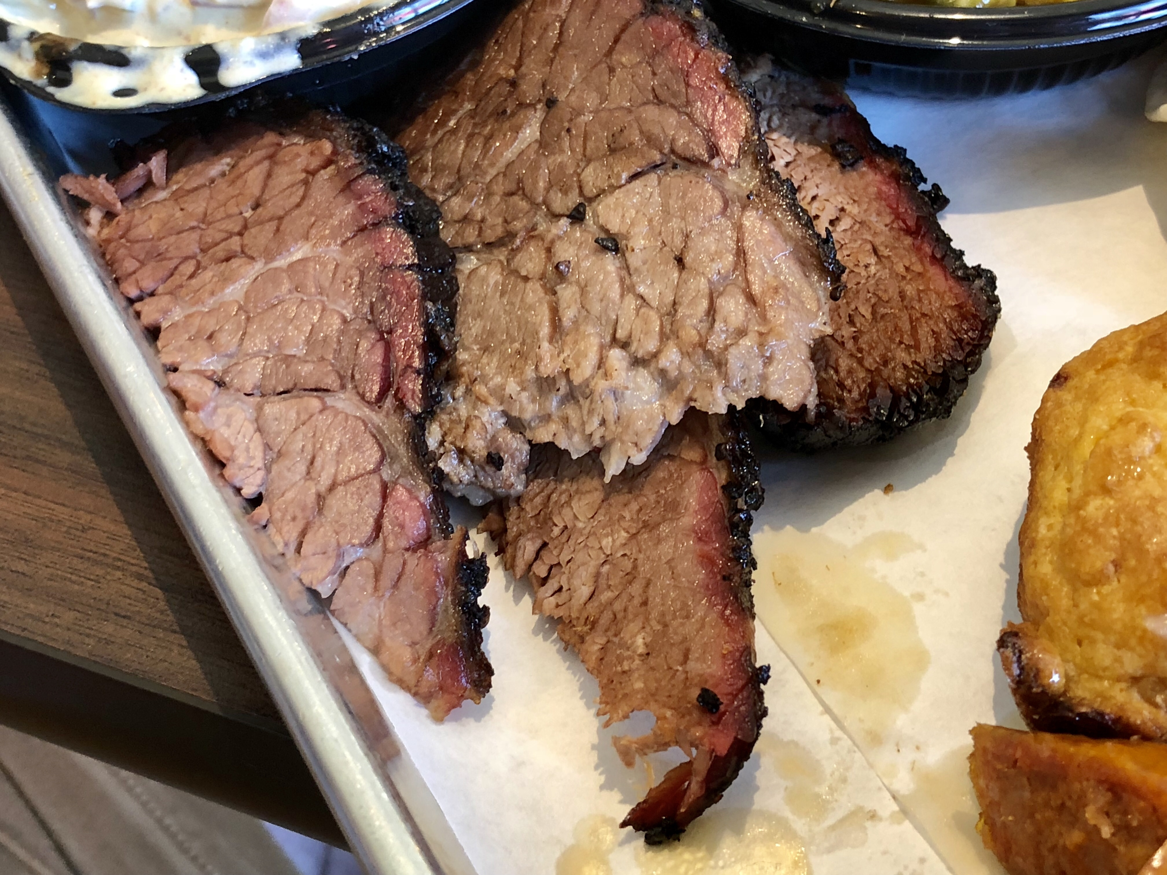 The brisket at Smoke BBQ in Audubon is minimalist in the Texas style, but peppery, tender, smoky and good.