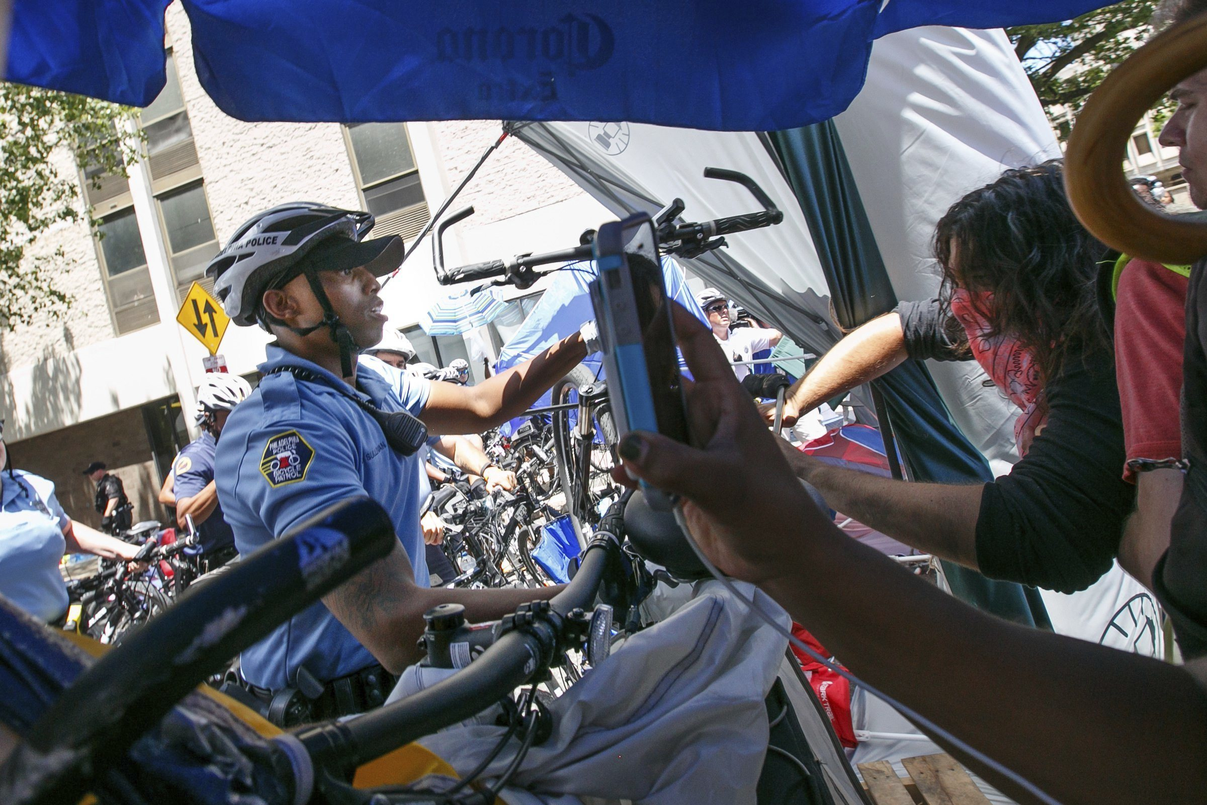 Police confront demonstrators outside the federal Immigration and Customs Enforcement agency on Thursday, July 5, 2018 in Philadelphia. Several protesters were arrested.