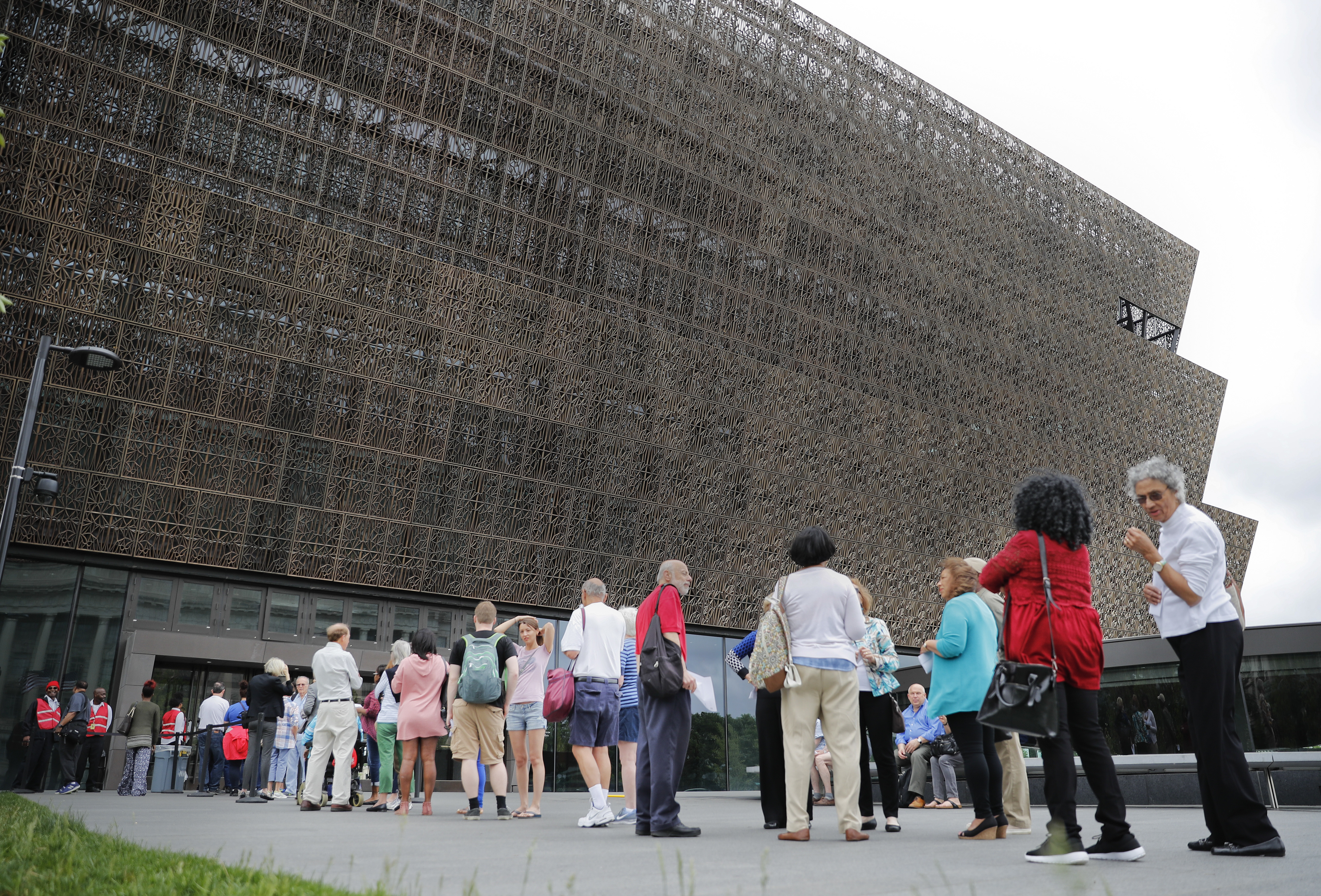 FILE- In this May 1, 2017, file photo, people wait in line to enter the Smithsonian National Museum of African American History and Cultural on the National Mall in Washington. Smithsonian Secretary David Skorton said in a statement that a noose was found on Wednesday, May 31, in the Segregation Gallery of the museum. (AP Photo/Pablo Martinez Monsivais, File)