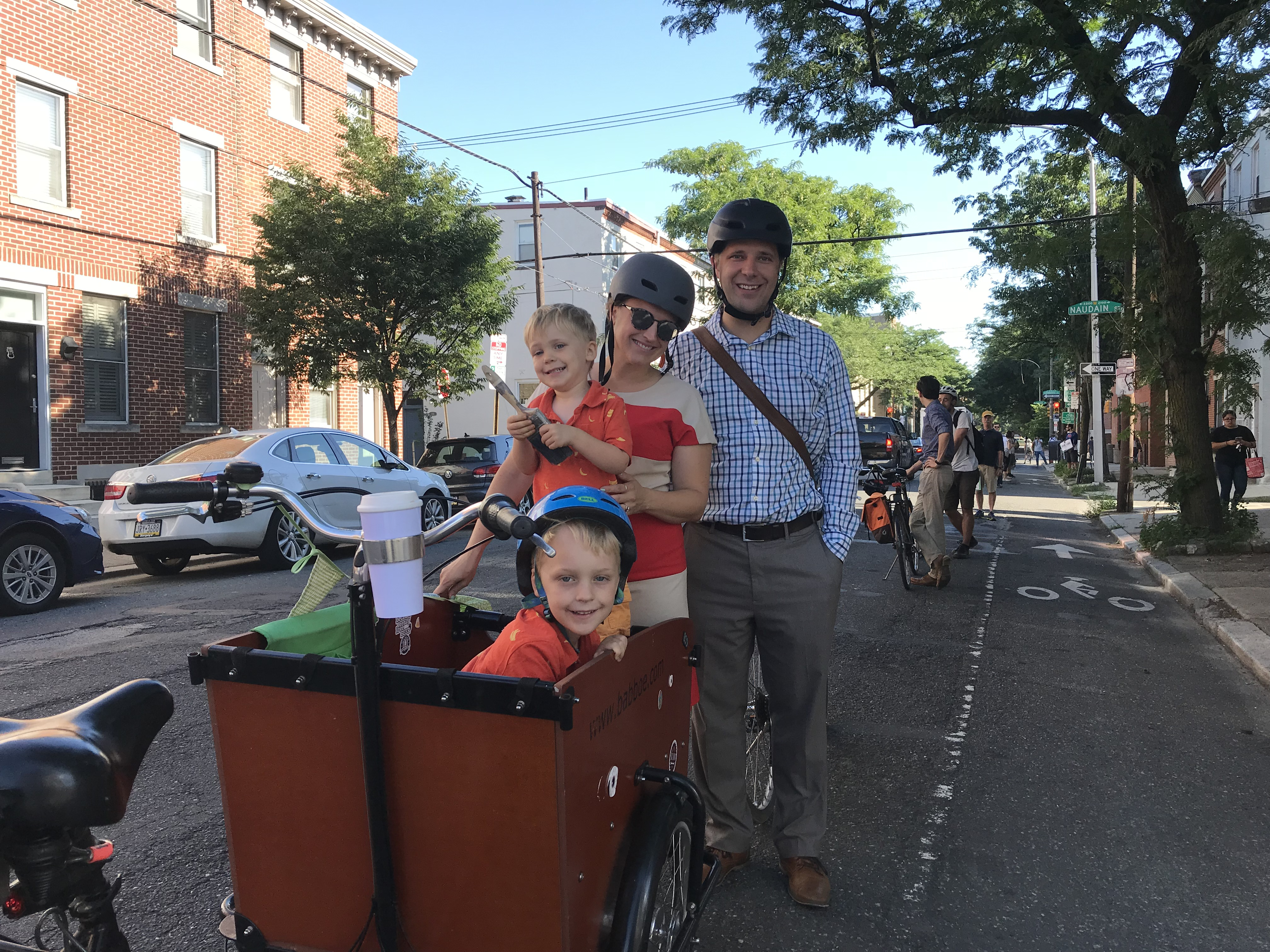 Robert and Kelly Piasecki, with their children Miles and Owen, joined a demonstration to draw attention to the poor condition of the bike lane on 22nd Street.