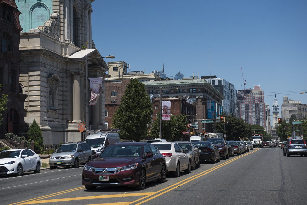 Cars are parked in the middle of Broad Street between Ellsworth and Federal Streets. A study found that Philadelphia is estimated to have more than two million parking spots, outnumbering the city's population.