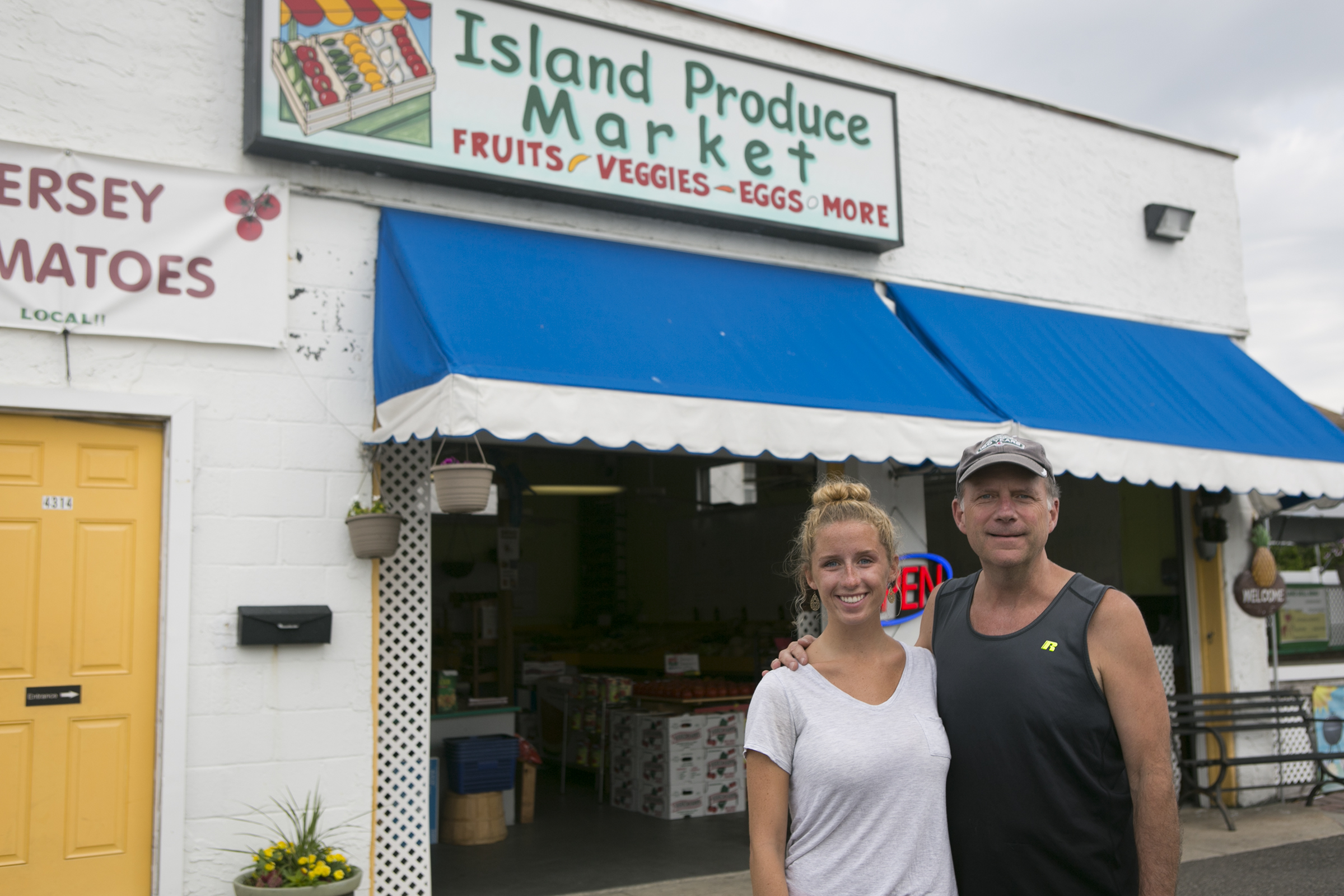 Owner Dave Mayer and his daughter Katie, 19, stand outside their business, Island Produce Market, in Wildwood, N.J., on the morning of Thursday, July 12, 2018. MAGGIE LOESCH / Staff Photographer