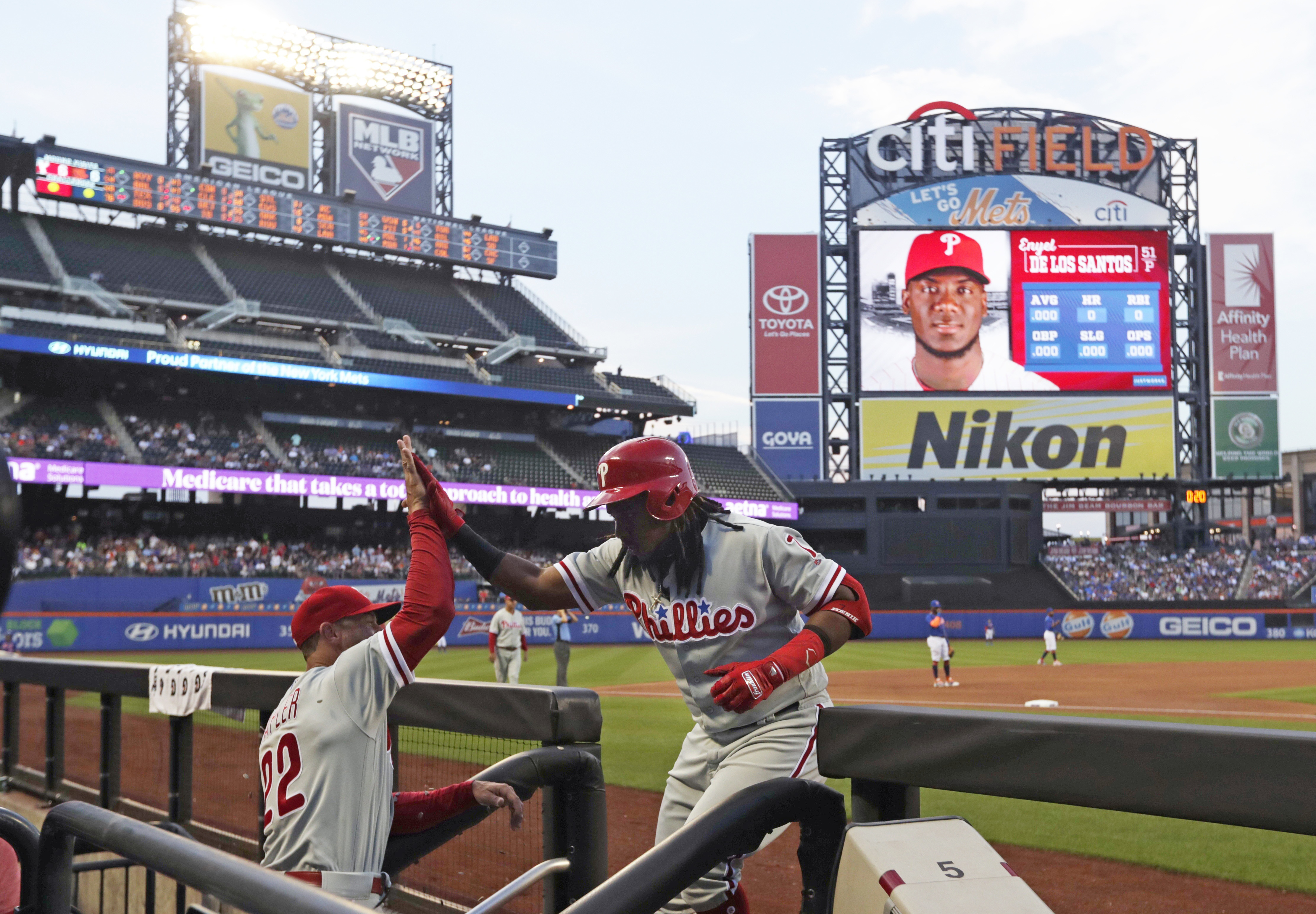 Phillies third baseman Maikel Franco celebrates with Gabe Kapler after his second-inning home run Tuesday night against the New York Mets.