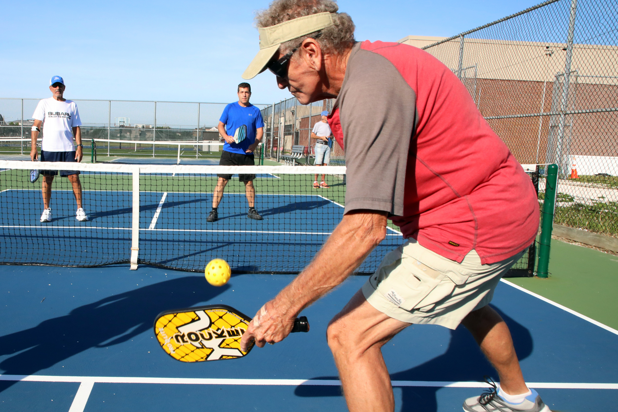 Bob Murphy, of Ocean City and Marathon, FL., returns a shot on the the advanced-player pickleball courts in Ocean City, Friday, June 29, 2018.