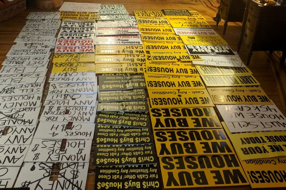 Some of the 200+ ´bandit signs´ Michael Froehlich collected after offering neighbors $1 per sign. The city is launching its own bounty program.