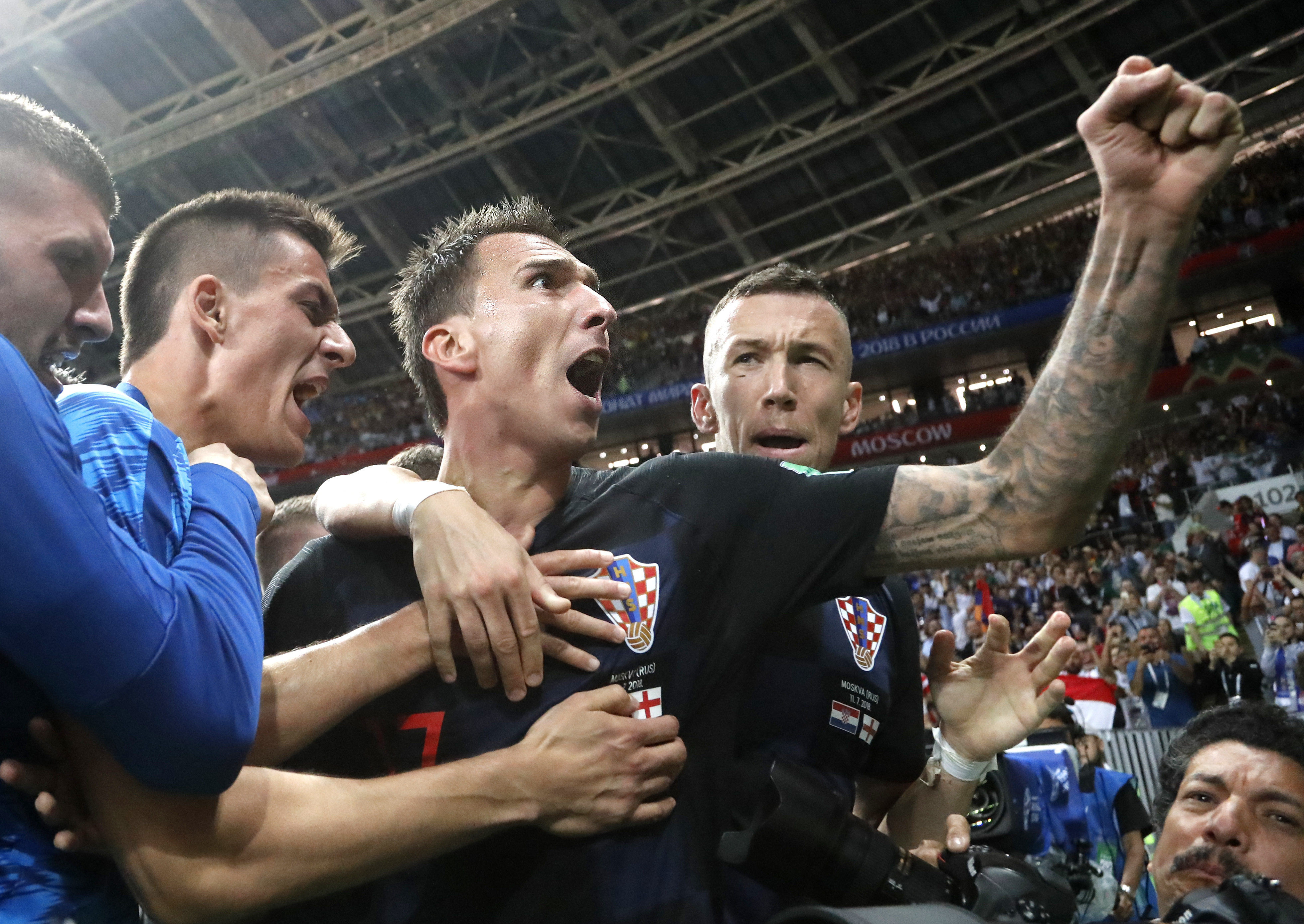 Croatia´s Mario Mandzukic, center, celebrates after scoring his side´s second goal during the semifinal match between Croatia and England at the 2018 soccer World Cup in the Luzhniki Stadium in Moscow, Russia, Wednesday, July 11, 2018.