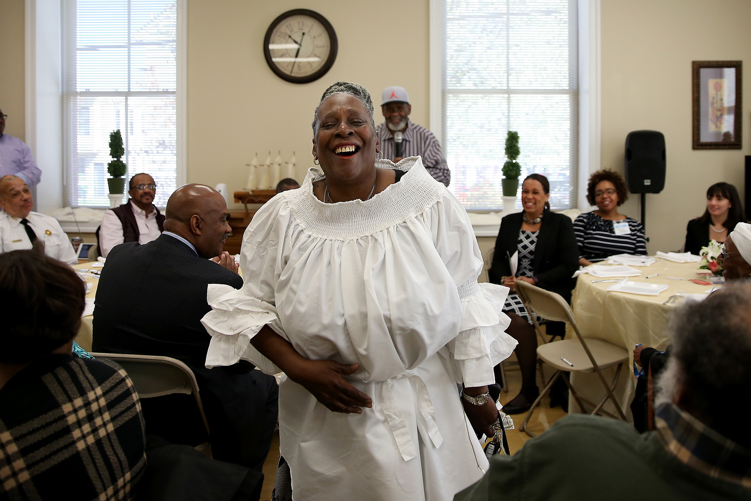 Harriett Ahmad, center, laughs as her husband, Sultan Ahmad, in the center background, compliments her. The AhmadÕs mark the anniversary of their son´s Sultan Jihad Ahmad´s murder 26 years ago with an annual peace breakfast in his memory for families that have lost loved ones to violence in Philadelphia, PA on April 20, 2018.