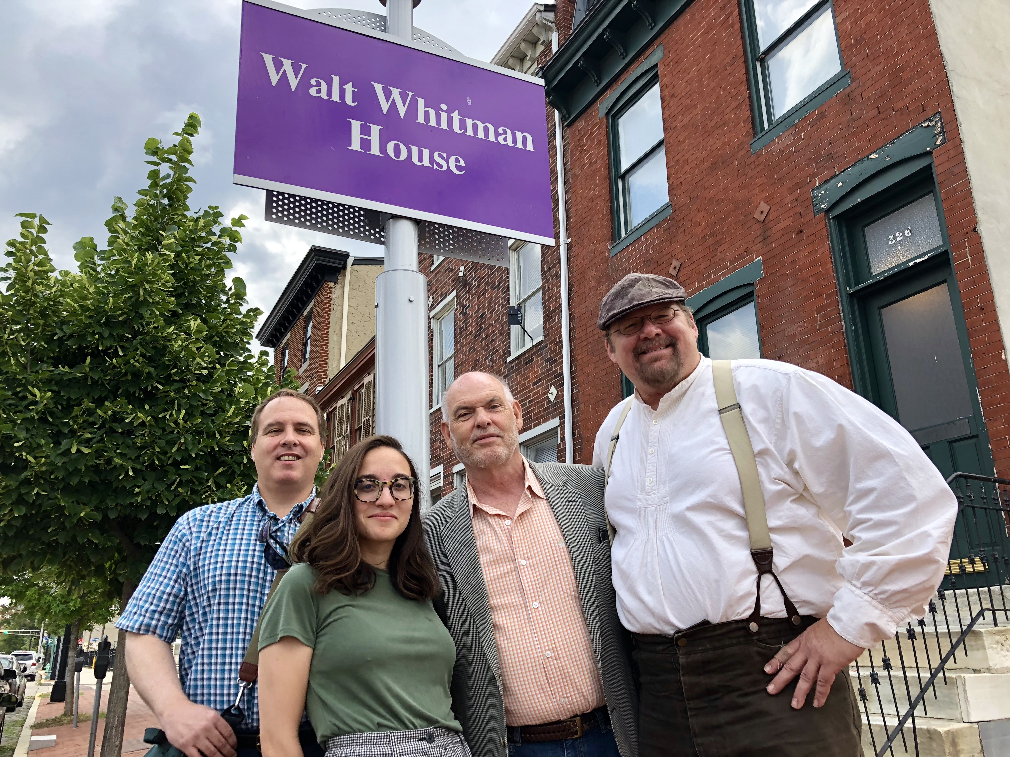 At outside the Walt Whitman House with Paul Kenney, Pauline Miller, John McPeak and Leo Blake. Blake is curator of the house, Miller is his assistant, and McPeak and Kenney are board members of the Walt Whitman Association. The three houses around the two-story Whitman house will be restored.