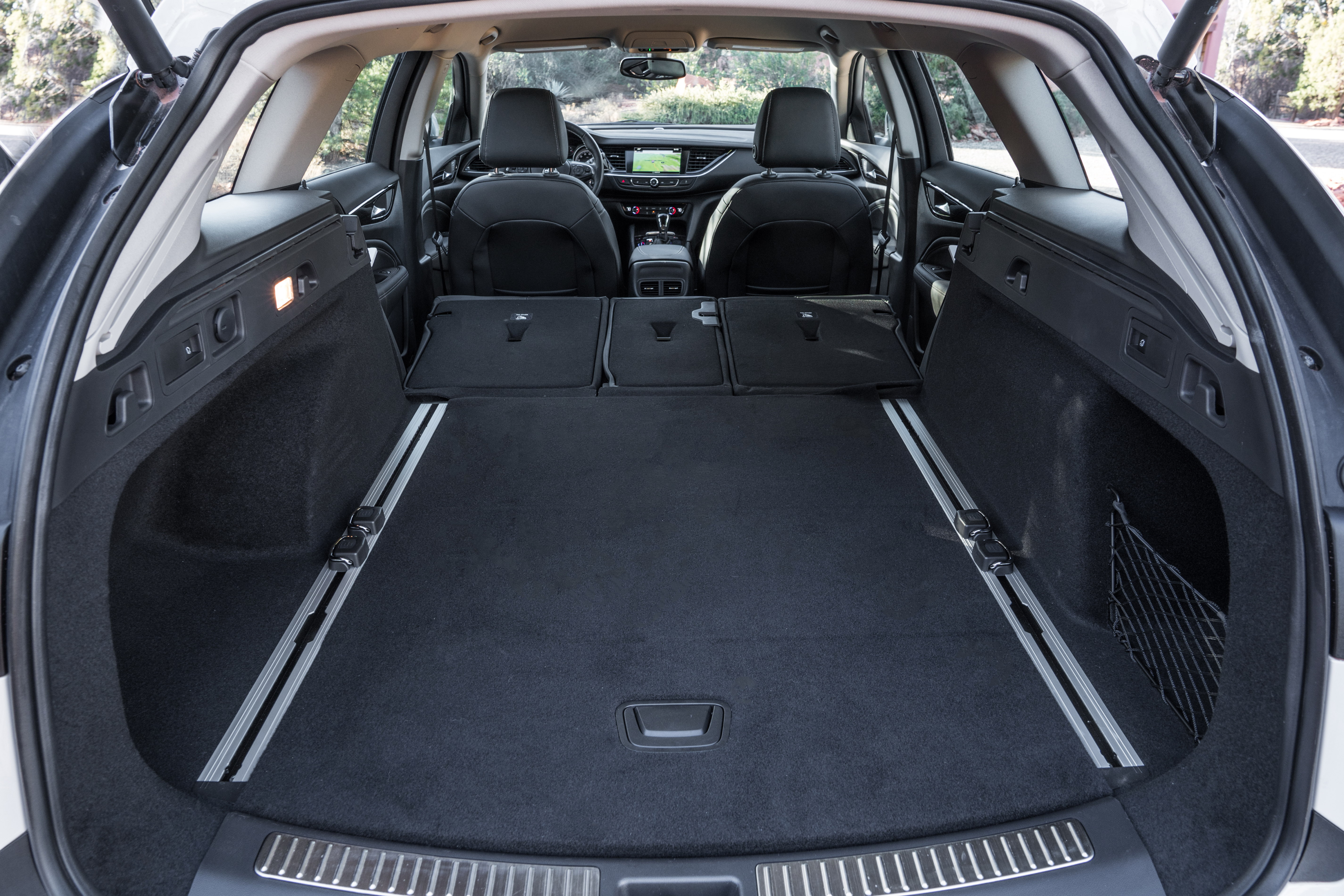 The interior of the 2018 Buick Regal TourX aims for simple but feels very plain. The seats are awesome, though, and space is generous for cargo and passengers.
