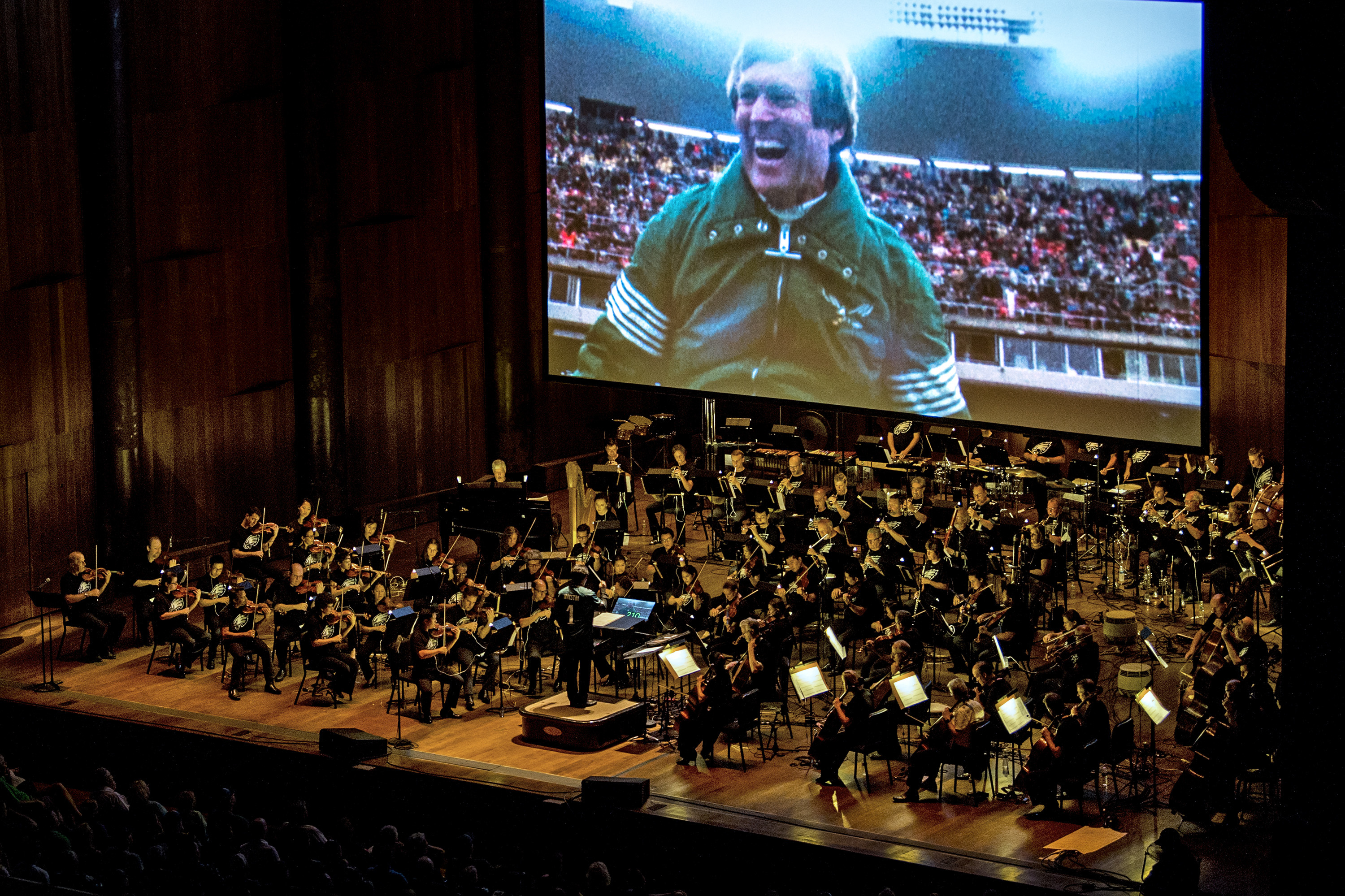 Head coach Dick Vermeil is shown in an Eagles video highlights film after defeating the Dallas Cowboys for the NFC championship leading to Super Bowl XV, as the Philadelphia Orchestra, conducted by Aram Demirjian, at the Mann Center Tuesday night.