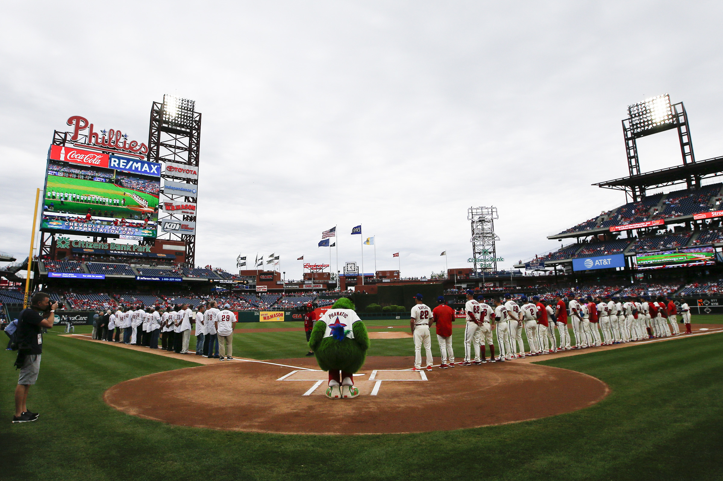 Players from the 1993 Phillies and current members line-up during a moment of silence for 1993 team members who have passed away before the Phillies played the Milwaukee Brewers on Sunday, June 10, 2018 in Philadelphia.