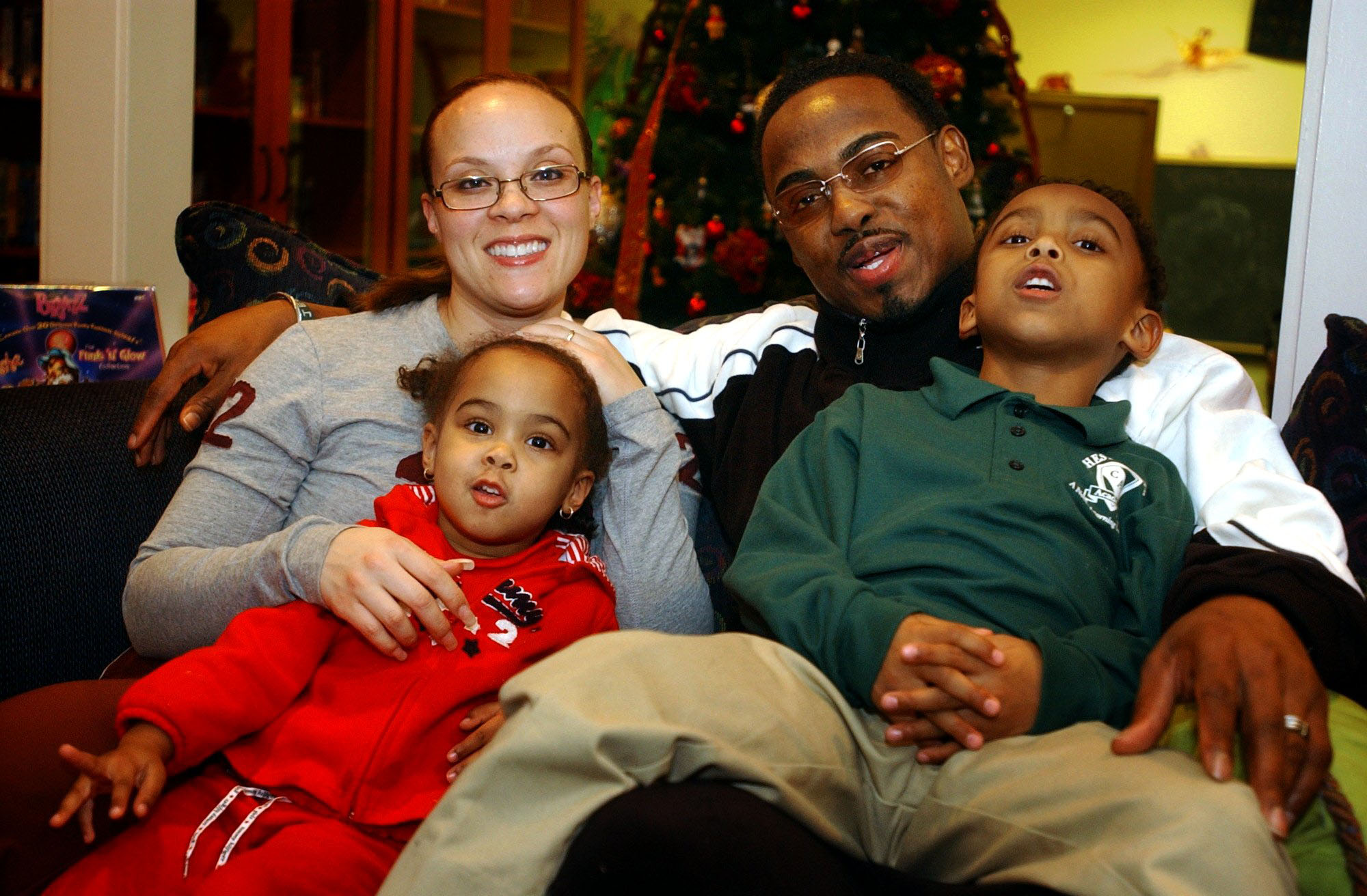 Connie and Brian Dawkins pose for a photo in January 2003 with children Brian Jr. (right), 6, and Brionni, 3.