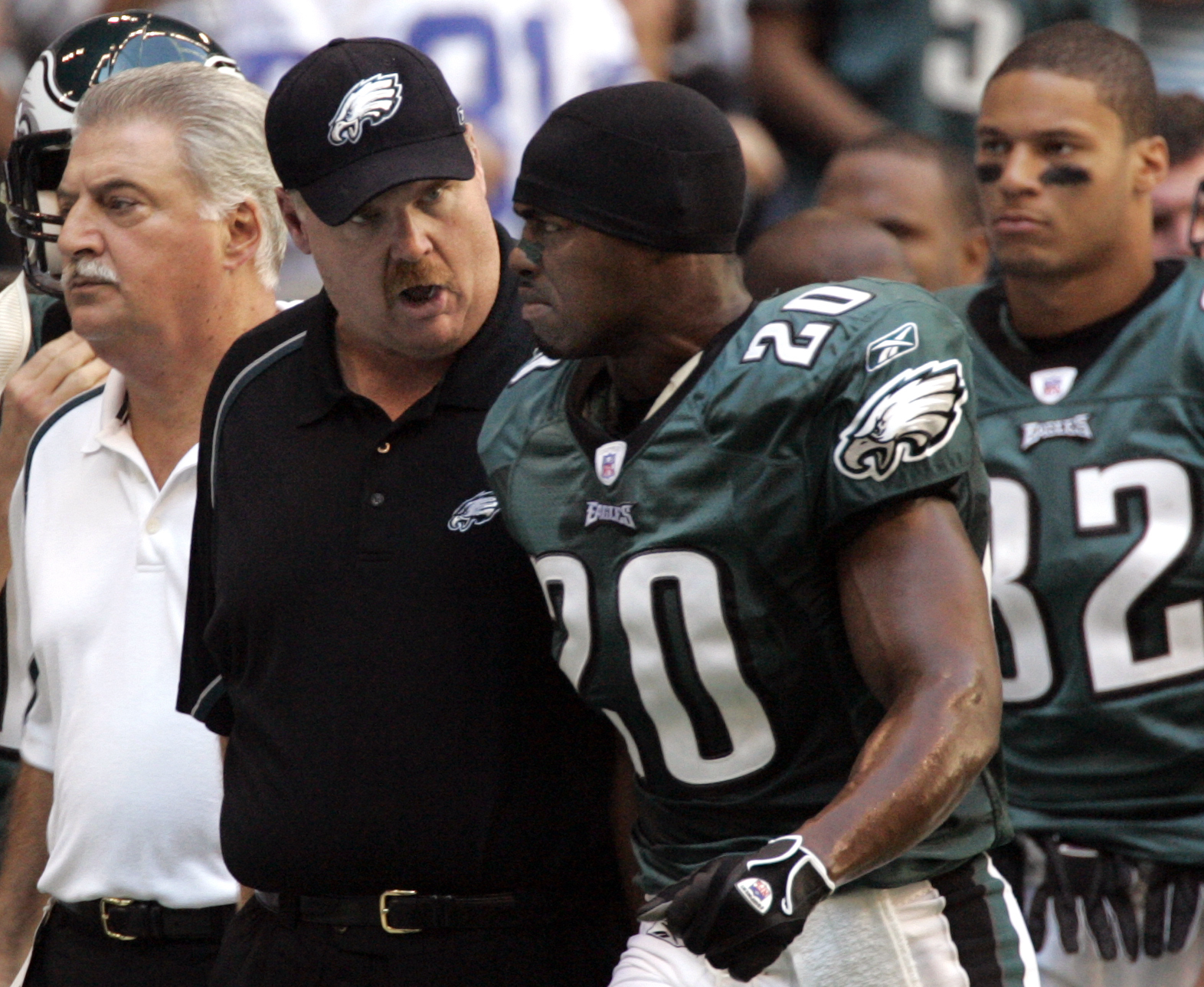 Former Eagles coach Andy Reid has a conversation with Brian Dawkins as Dawkins walks off the field during an October 2005 game.